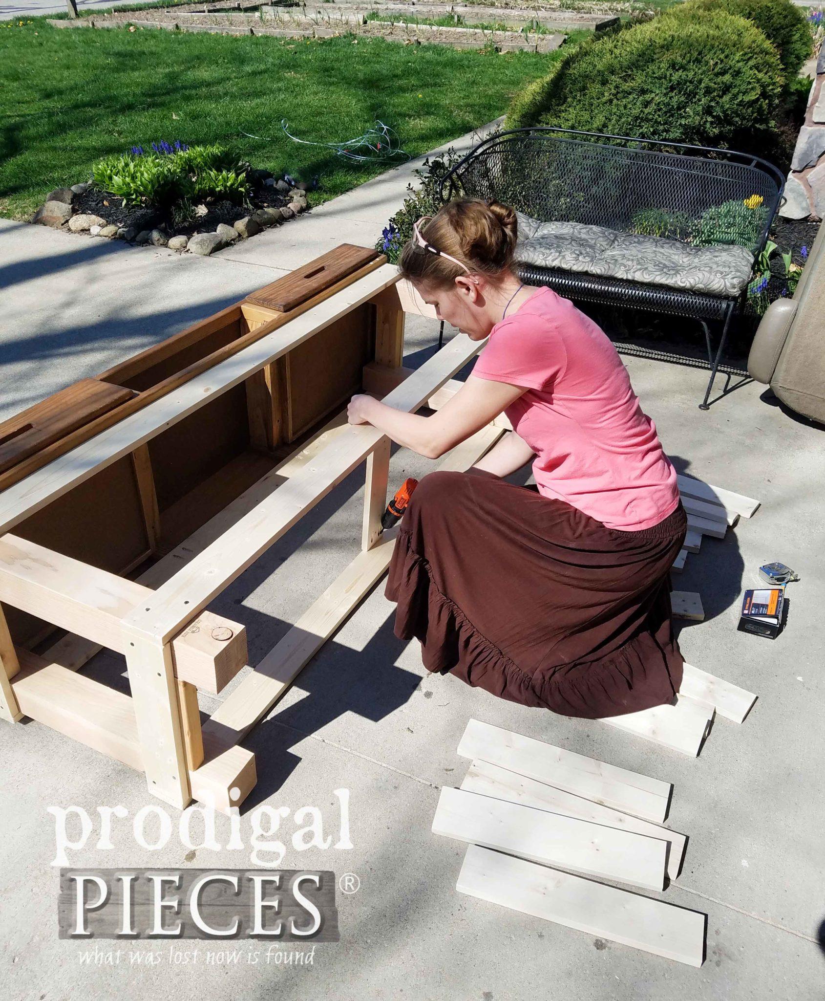 Assembling DIY Farmhouse Workbench built by Larissa of Prodigal Pieces | prodigalpieces.com