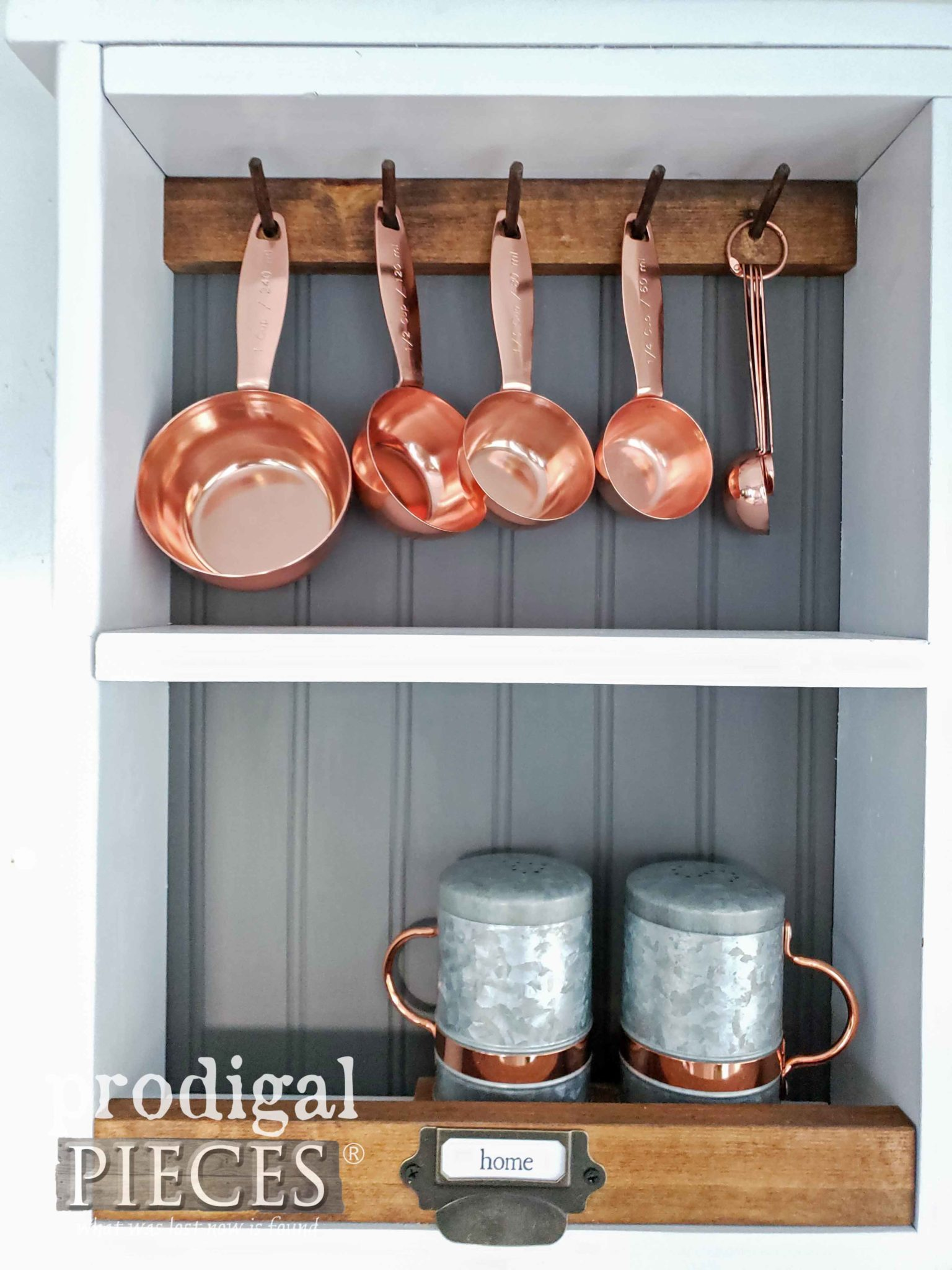 Copper Kitchen Bakeware Displayed in Farmhouse Storage Cubby by Prodigal Pieces | prodigalpieces.com
