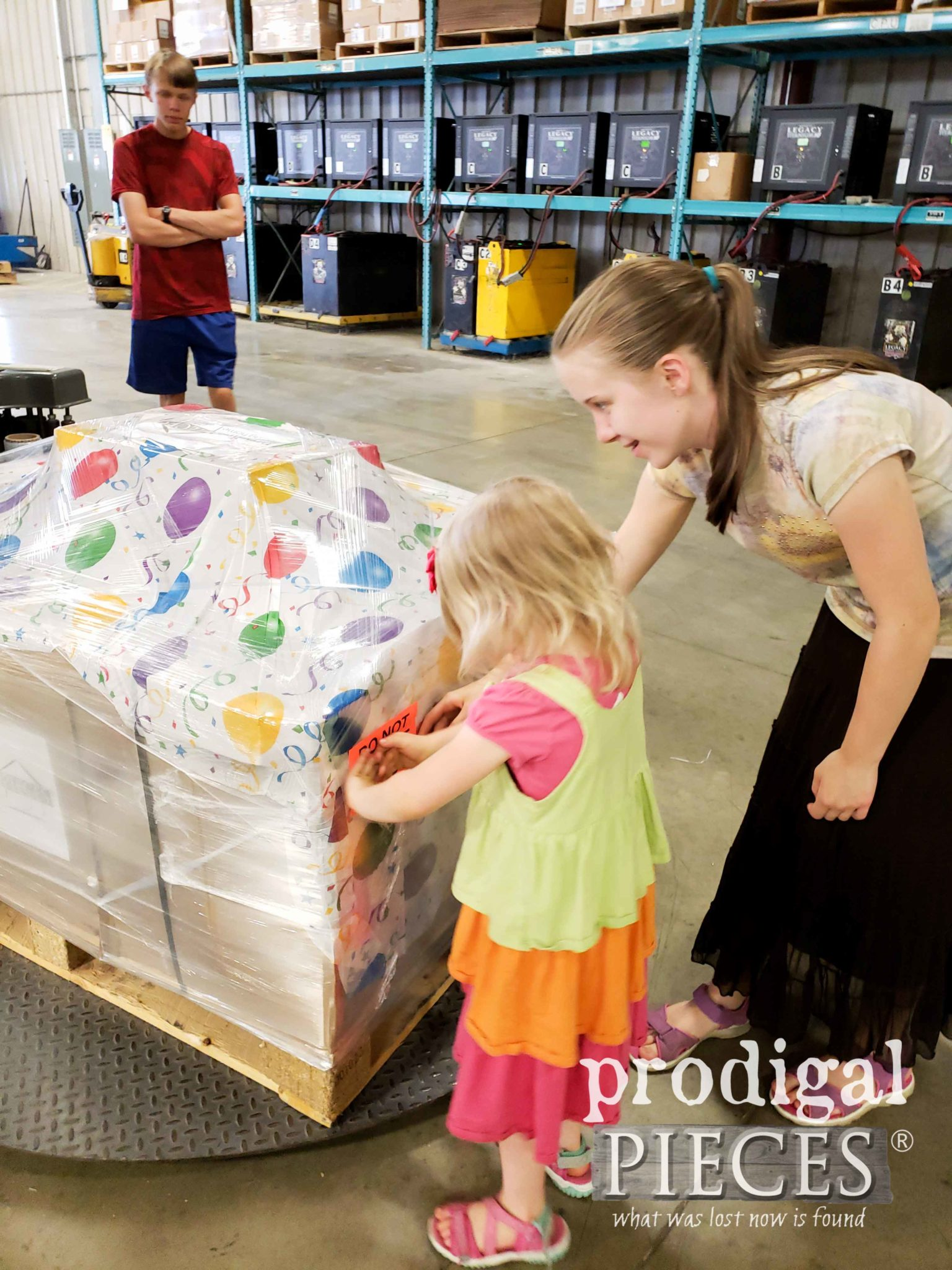 Haynes' Kids Helping Wrap Finding Home Furniture Shipment by Prodigal Pieces | prodigalpieces.com