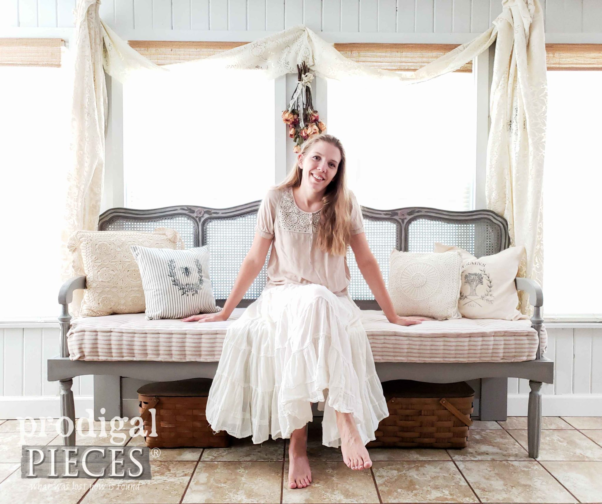 Larissa Haynes of Prodigal Pieces sitting on her custom made French Provincial Headboard bench with French Mattress | See the DIY details at prodigalpieces.com