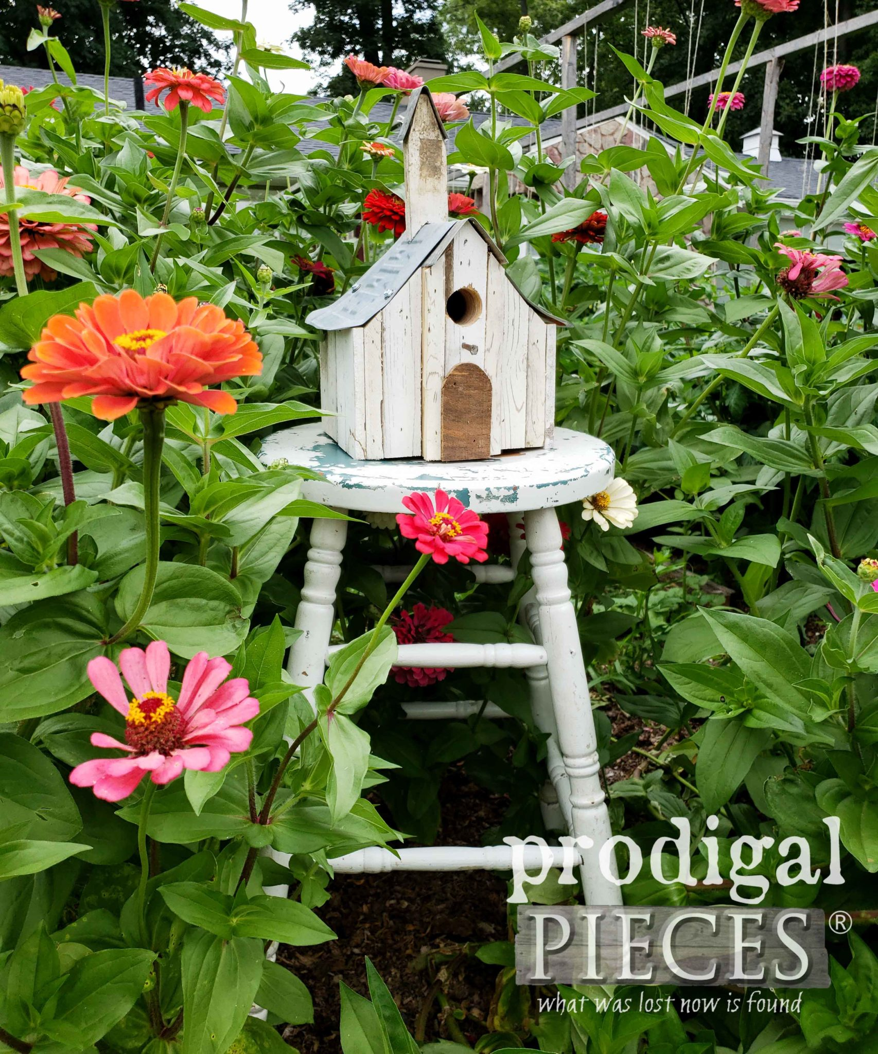 Old Church Birdhouse Sitting in Flower Garden | Made from Reclaimed Parts by Larissa of Prodigal Pieces | prodigalpieces.com