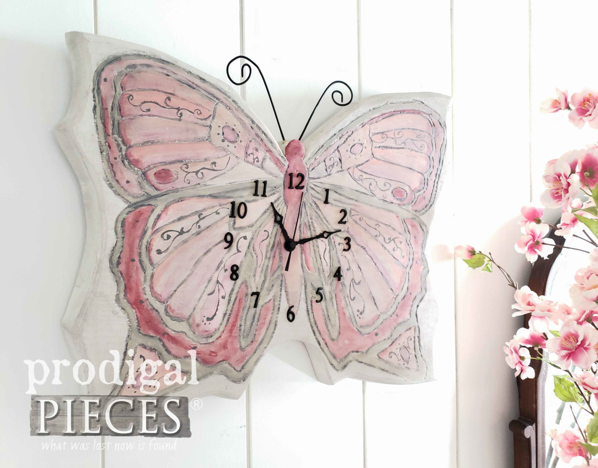 This upcycled butterfly wall clock was created and hand-painted by Larissa of Prodigal Pieces | prodigalpieces.com