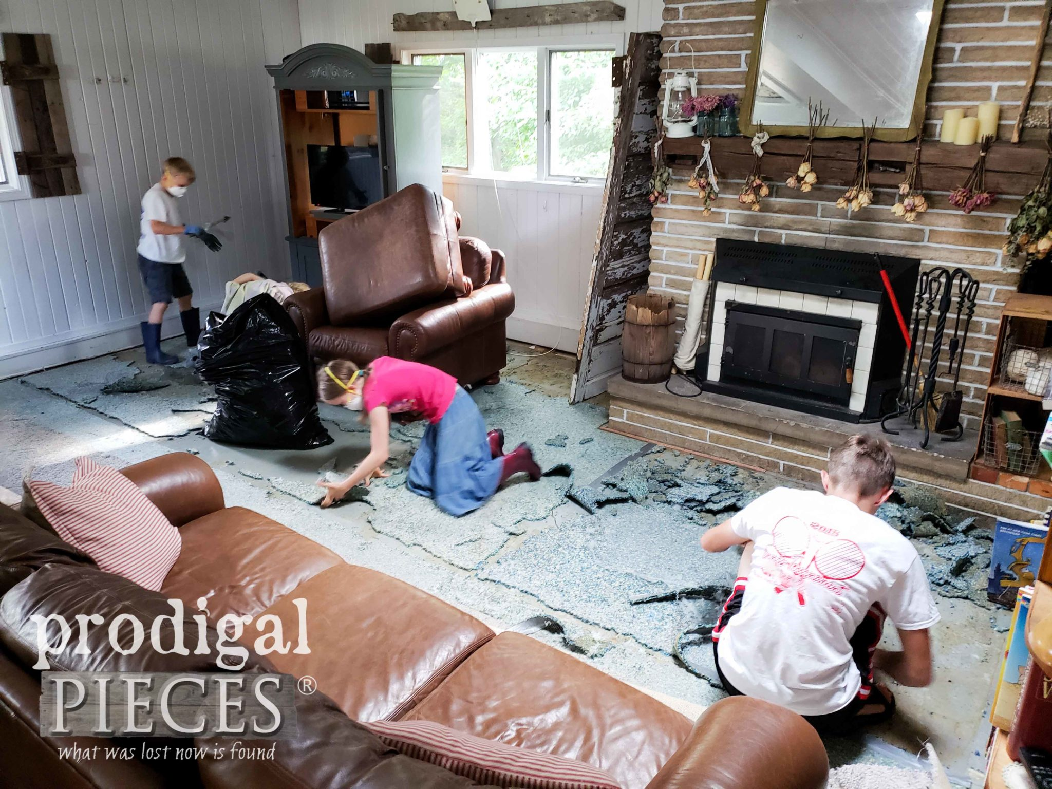 Kids Helping Tear Out Old Carpet | prodigalpieces.com
