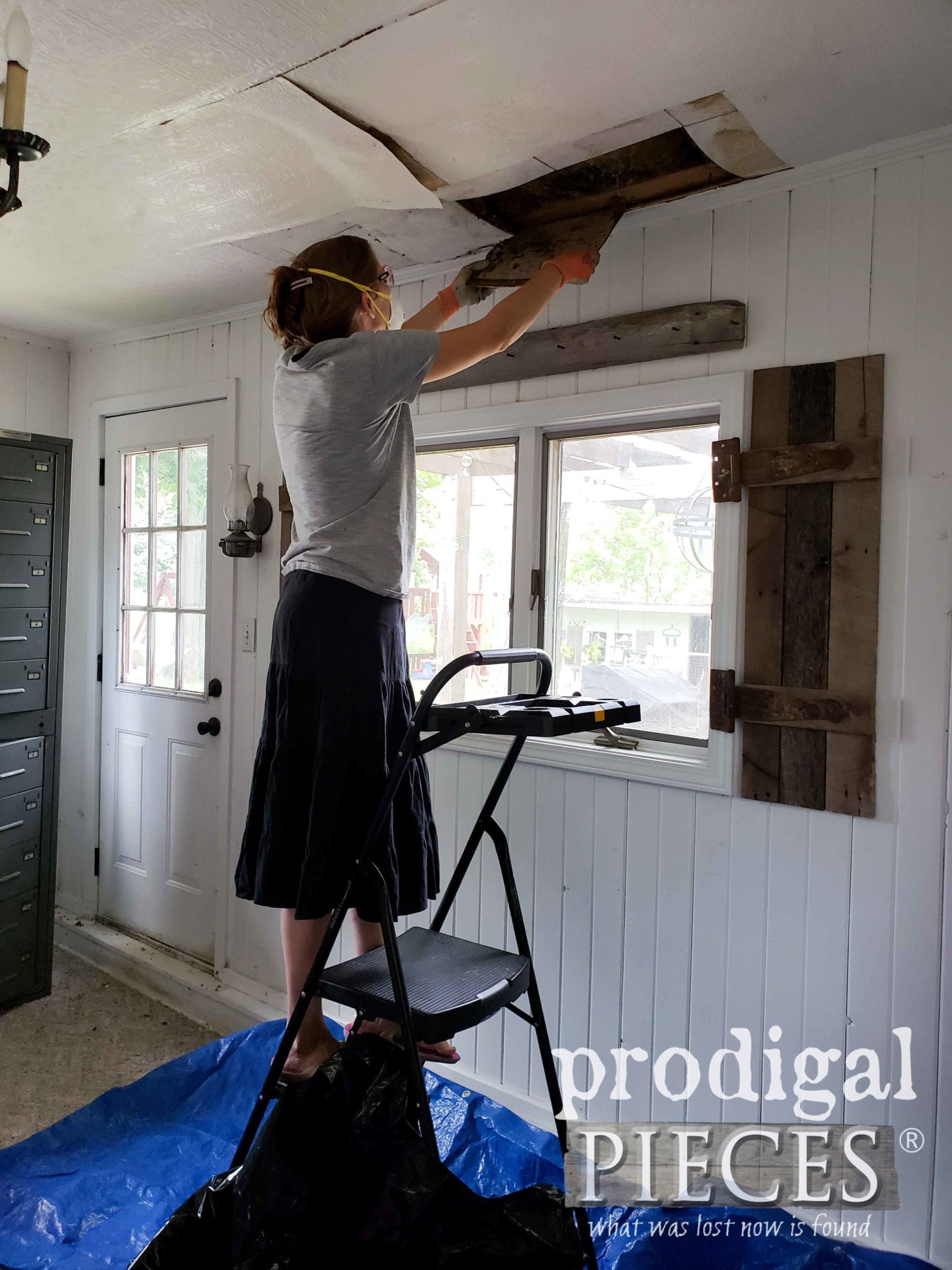 Larissa of Prodigal Pieces Tearing Down Damaged Family Room Ceiling | prodigalpieces.com