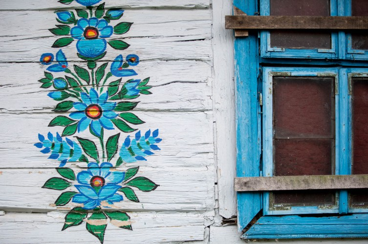 Blue Flowers on House in Zalipie, Poland by Aga Kozmic of A Matter of Taste via prodigalpieces.com