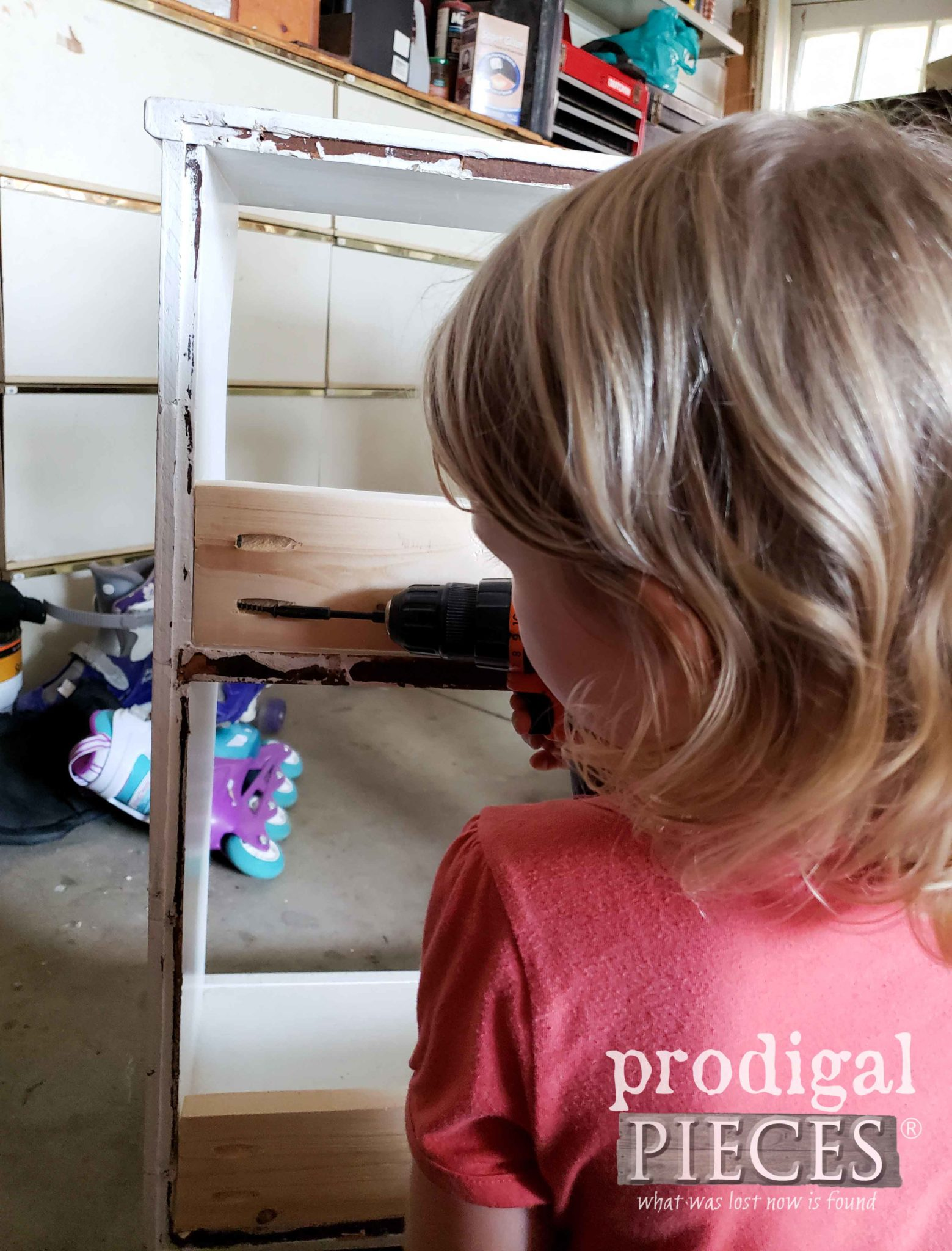 Daughter Helping Attach Bookcase Braces | prodigalpieces.com
