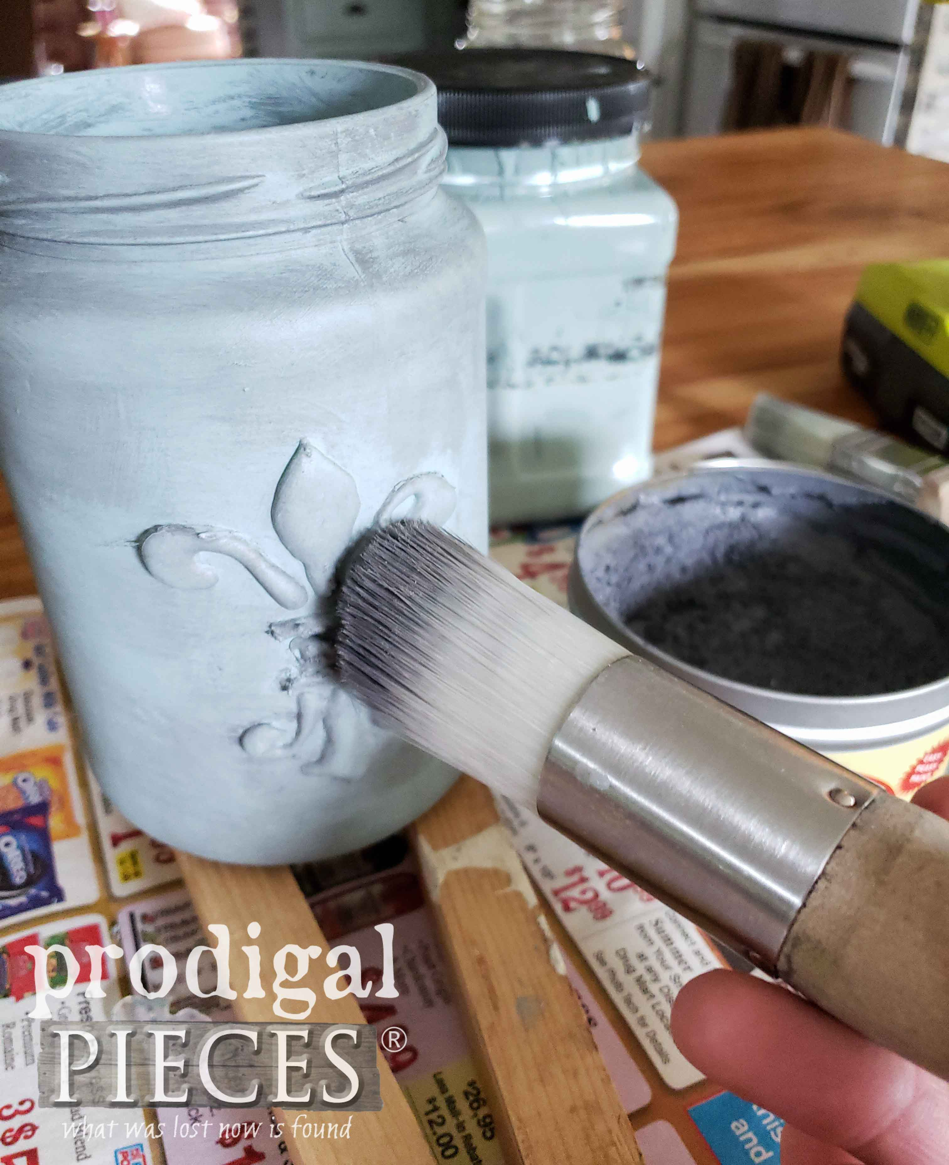 Applying Wax to Upcycled Jar Hangers | prodigalpieces.com