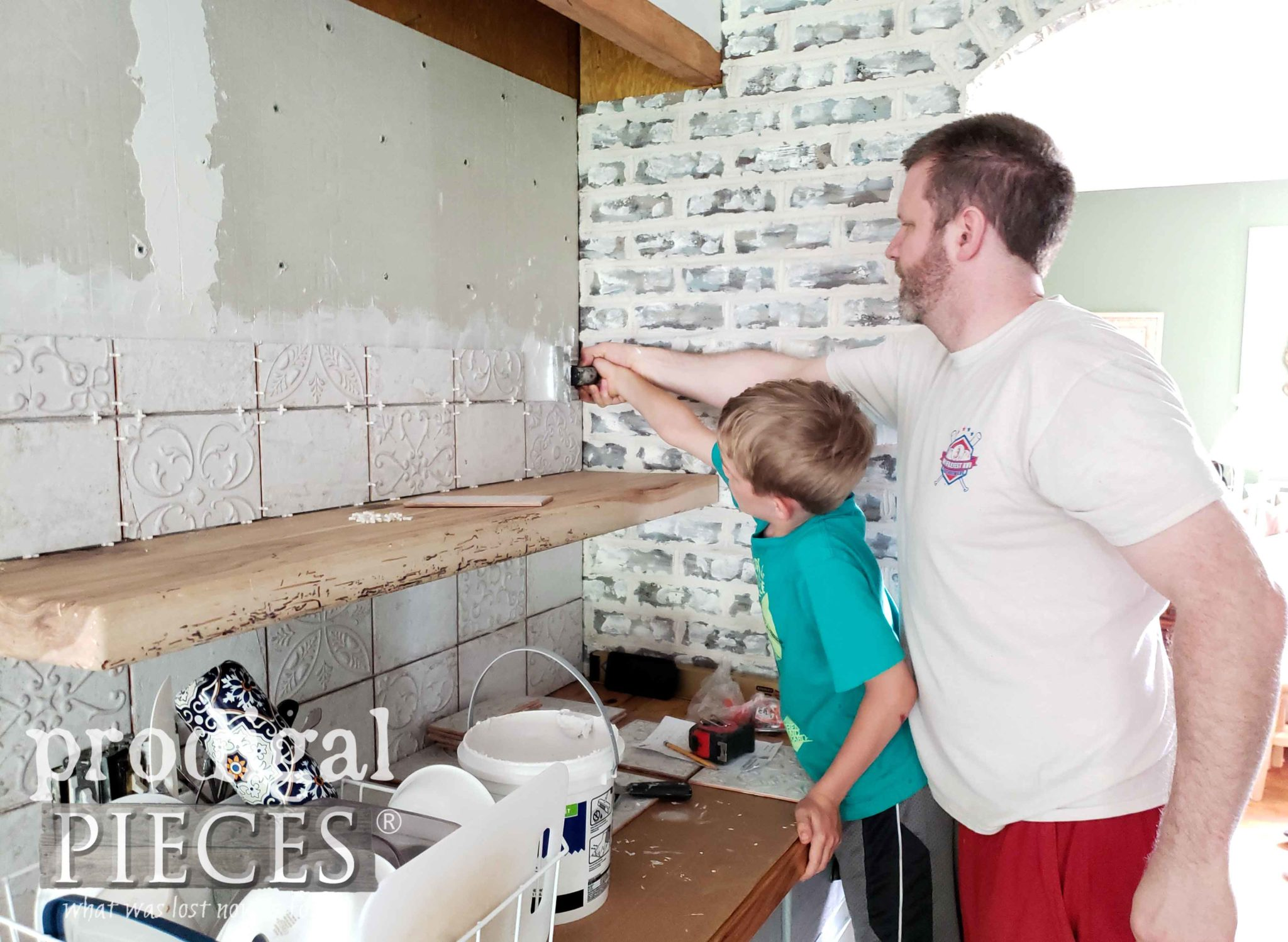 Dad and Son Hanging Kitchen Backsplash Tile in Farmhouse Kitchen Remodel | prodigalpieces.com