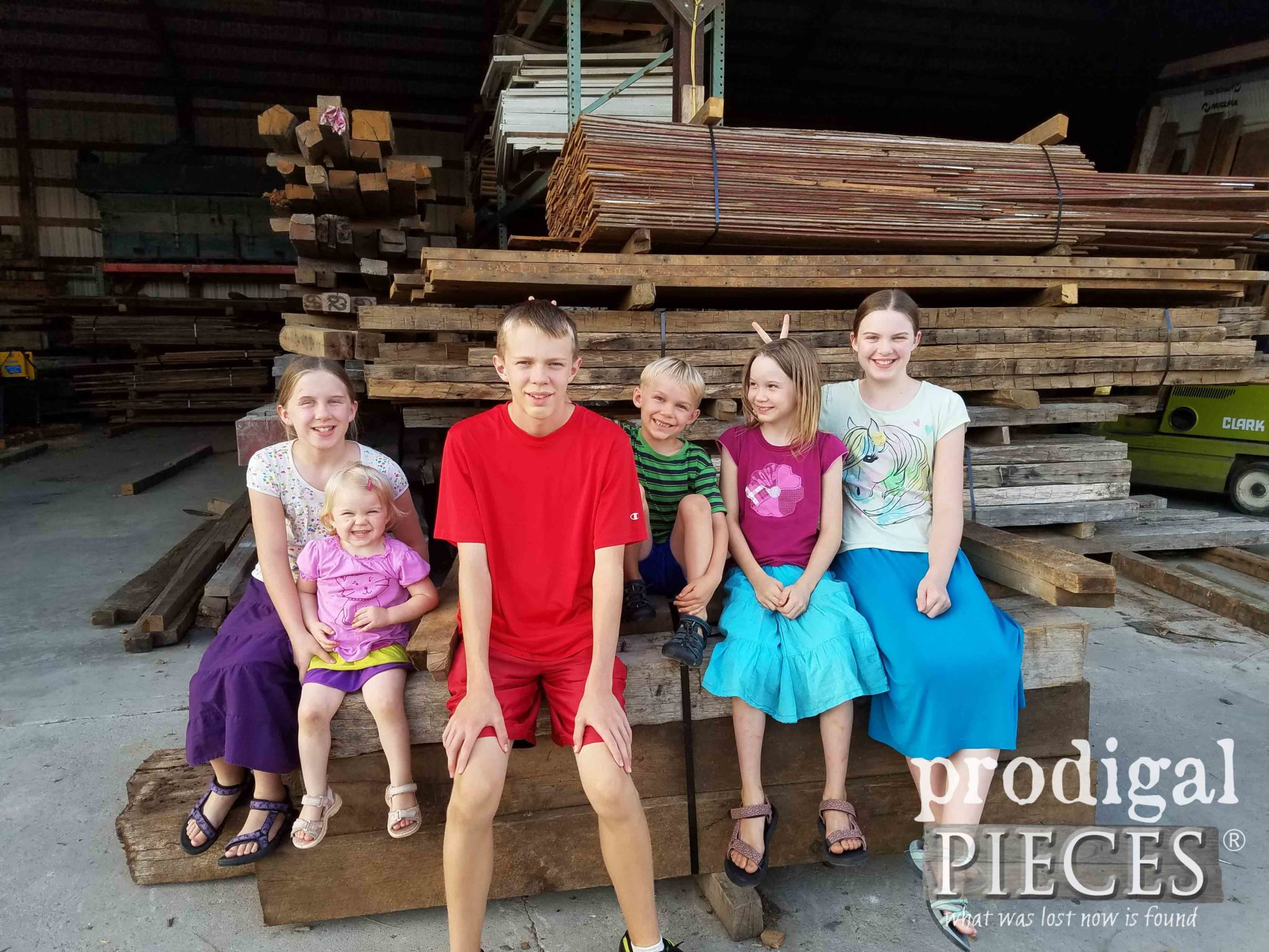 Kids Sitting on Reclaimed Wood Pile | prodigalpieces.com