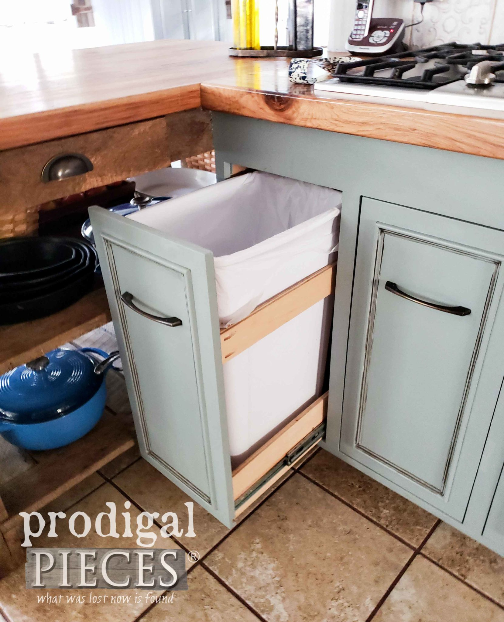 Kitchen Cupboard with Custom Trash Bin Drawer by Prodigal Pieces | prodigalpieces.com