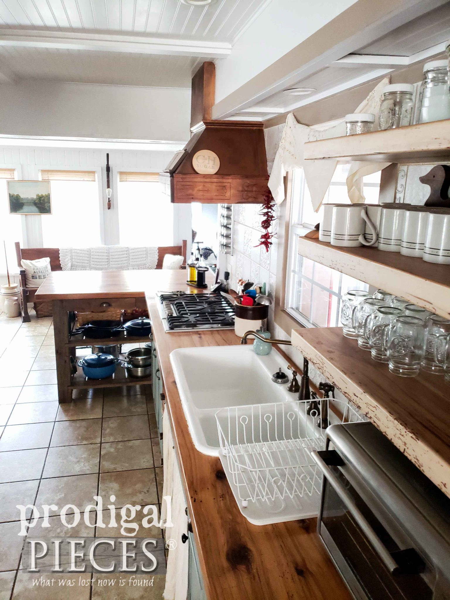 Wall of Kitchen with Open Shelving, Custom Range Hood, Reclaimed Counters and Embossed Tile by Prodigal Pieces | prodigalpieces.com