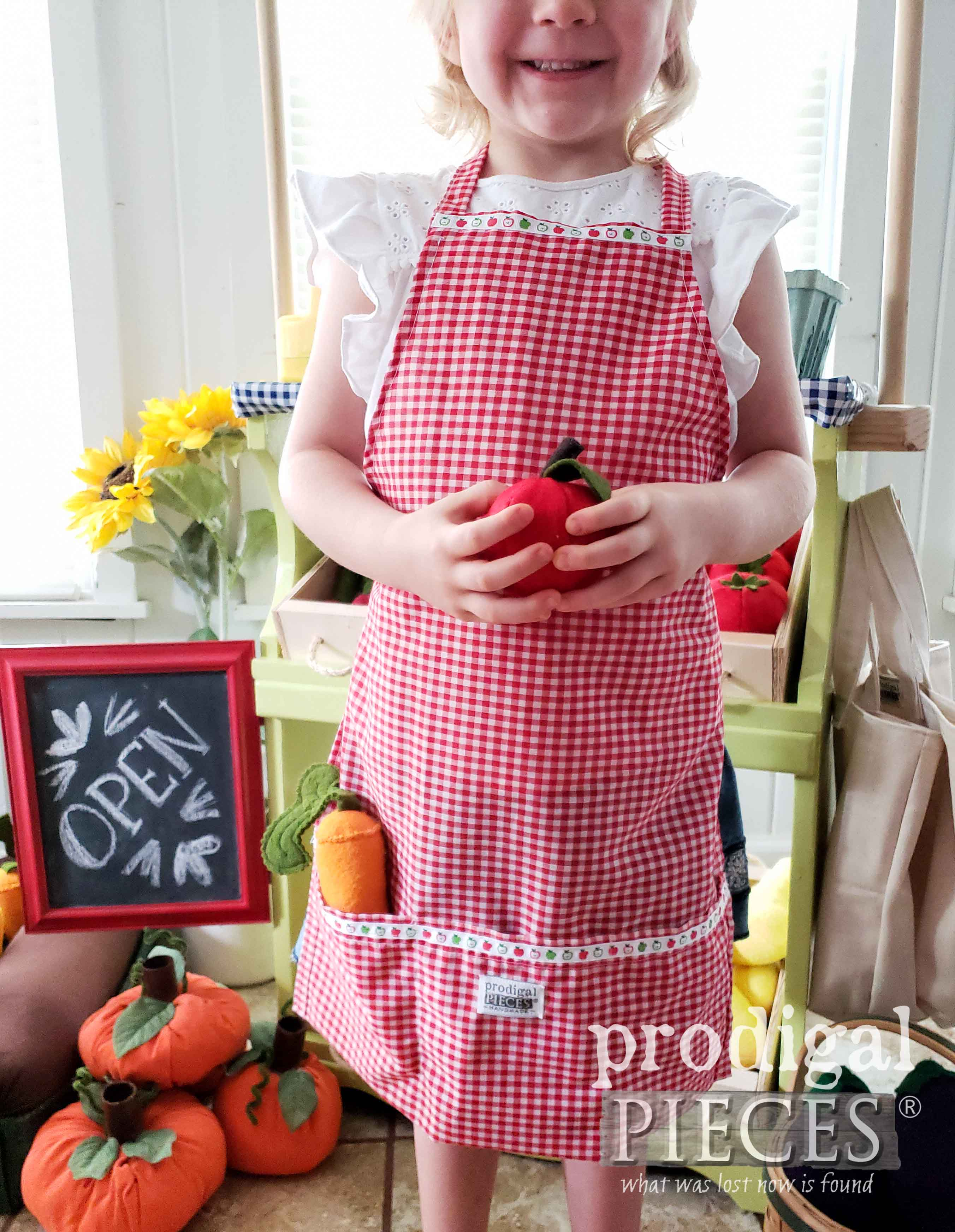 Absolutely adorable red gingham apron for kids | Handmade by Larissa of Prodigal Pieces | prodigalpieces.com
