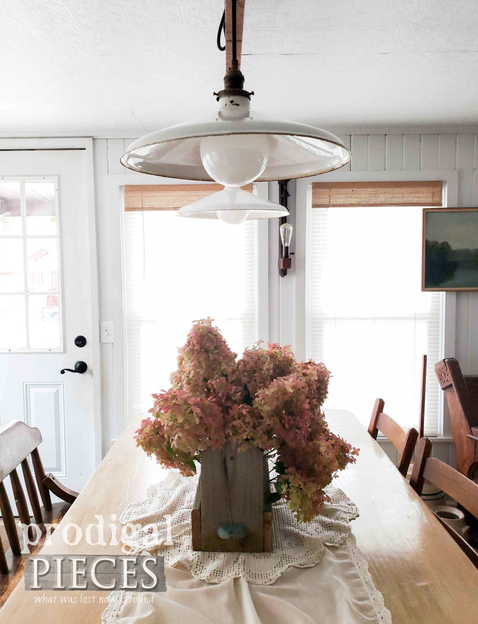 Rustic Farmhouse Dining Table with Enamel Lighting and Hydrangeas in Wood Tote by Prodigal Pieces | prodigalpieces.com