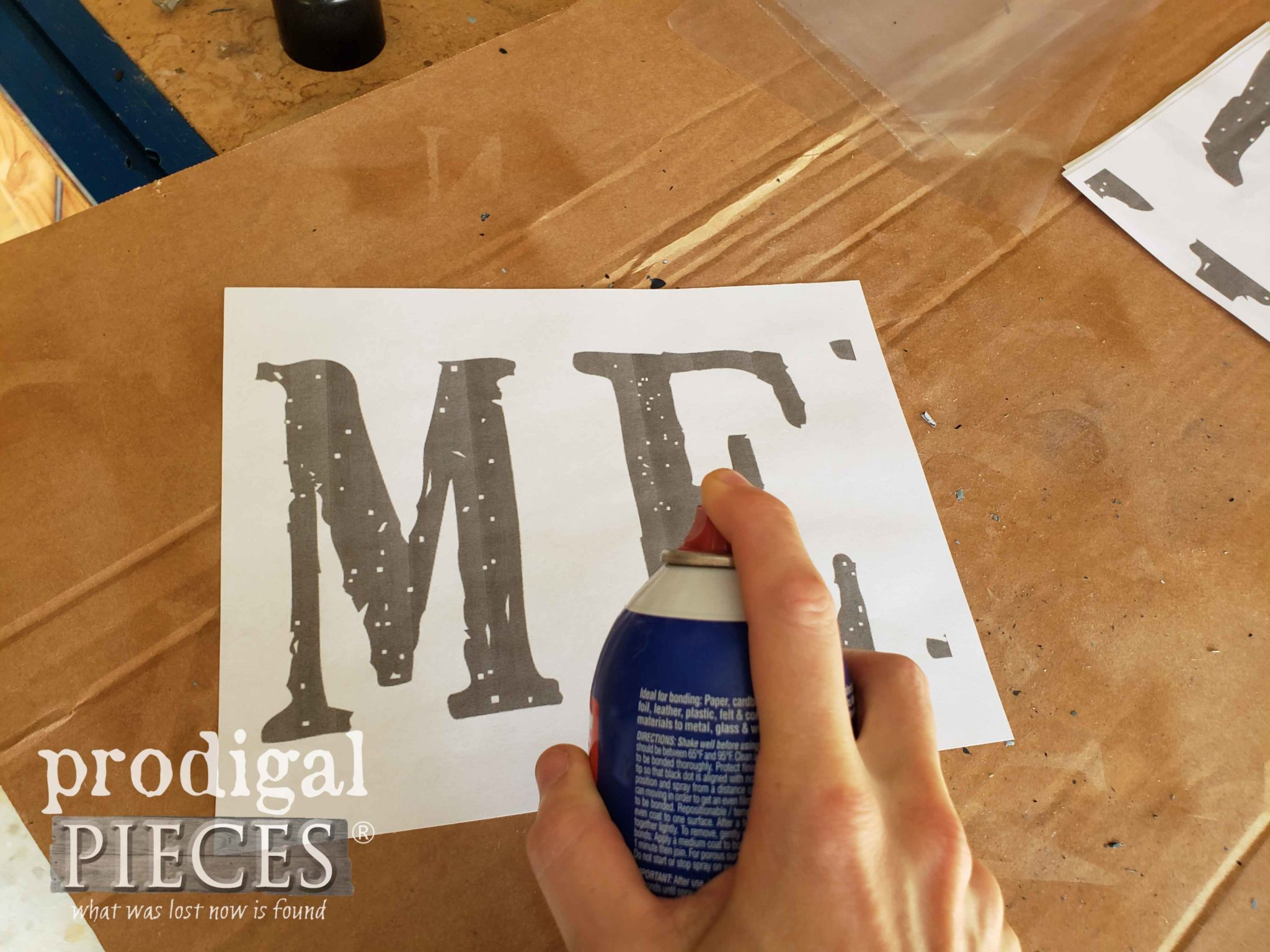 Spraying Adhesive onto Sign Paper | prodigalpieces.com