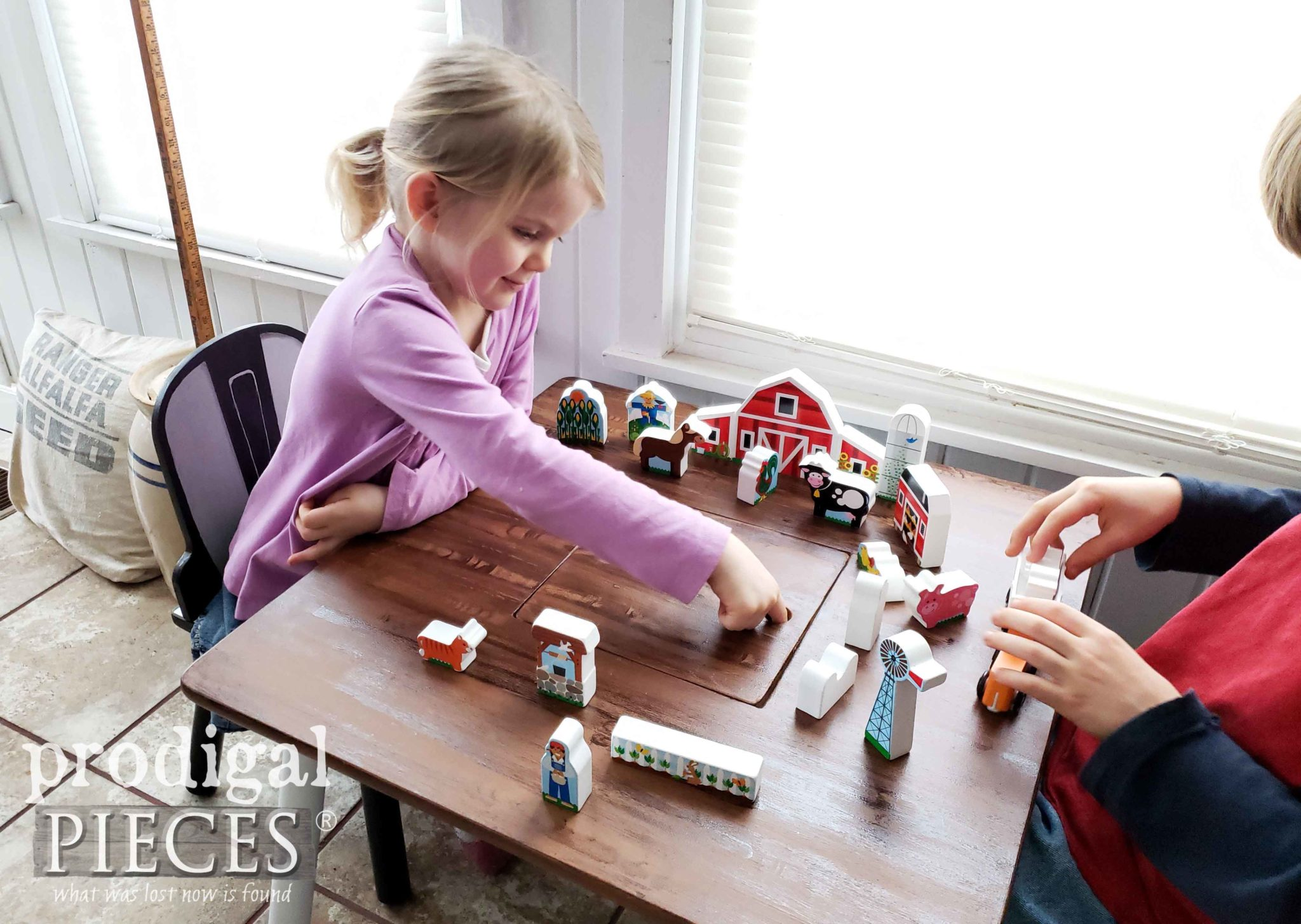 Toddler Playing with Modern Farmhouse Play Table Made New by Larissa of Prodigal Pieces | prodigalpieces.com