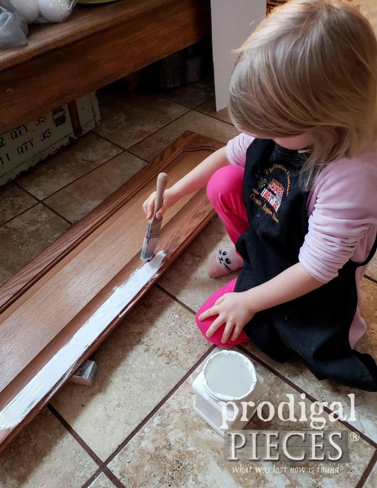 Toddler Painting Cupboard Door Snowman | prodigalpieces.com
