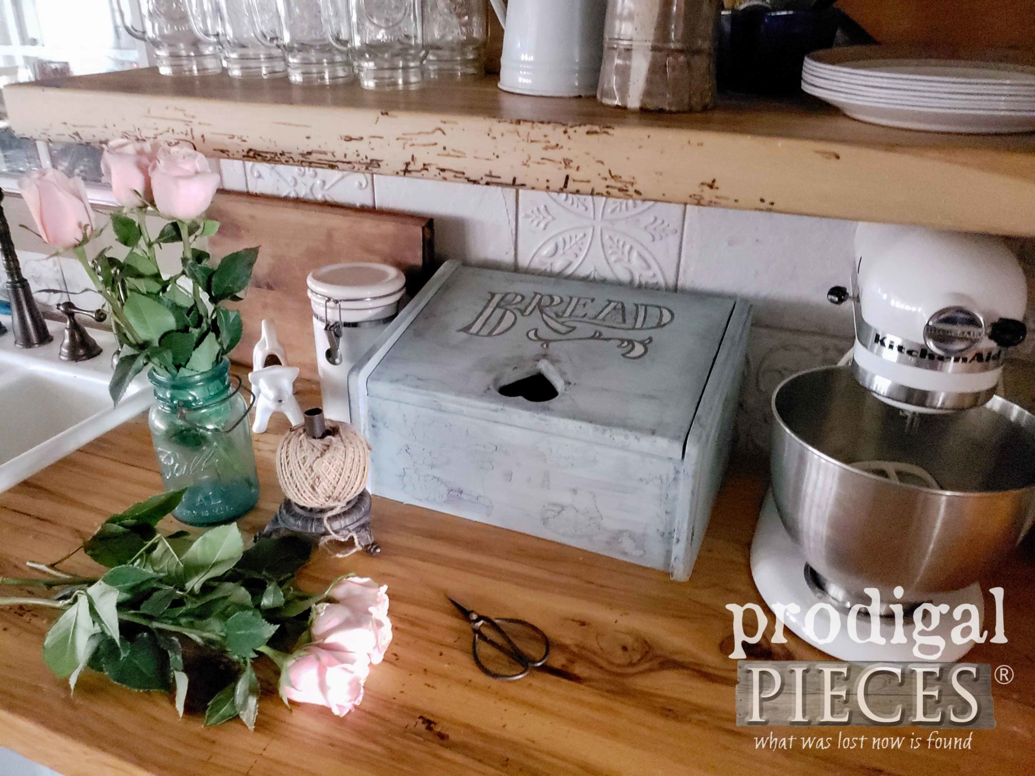 Absolutely cute cottage style kitchen charging station created from a vintage bread box. DIY by Larissa of Prodigal Pieces | prodigalpieces.com