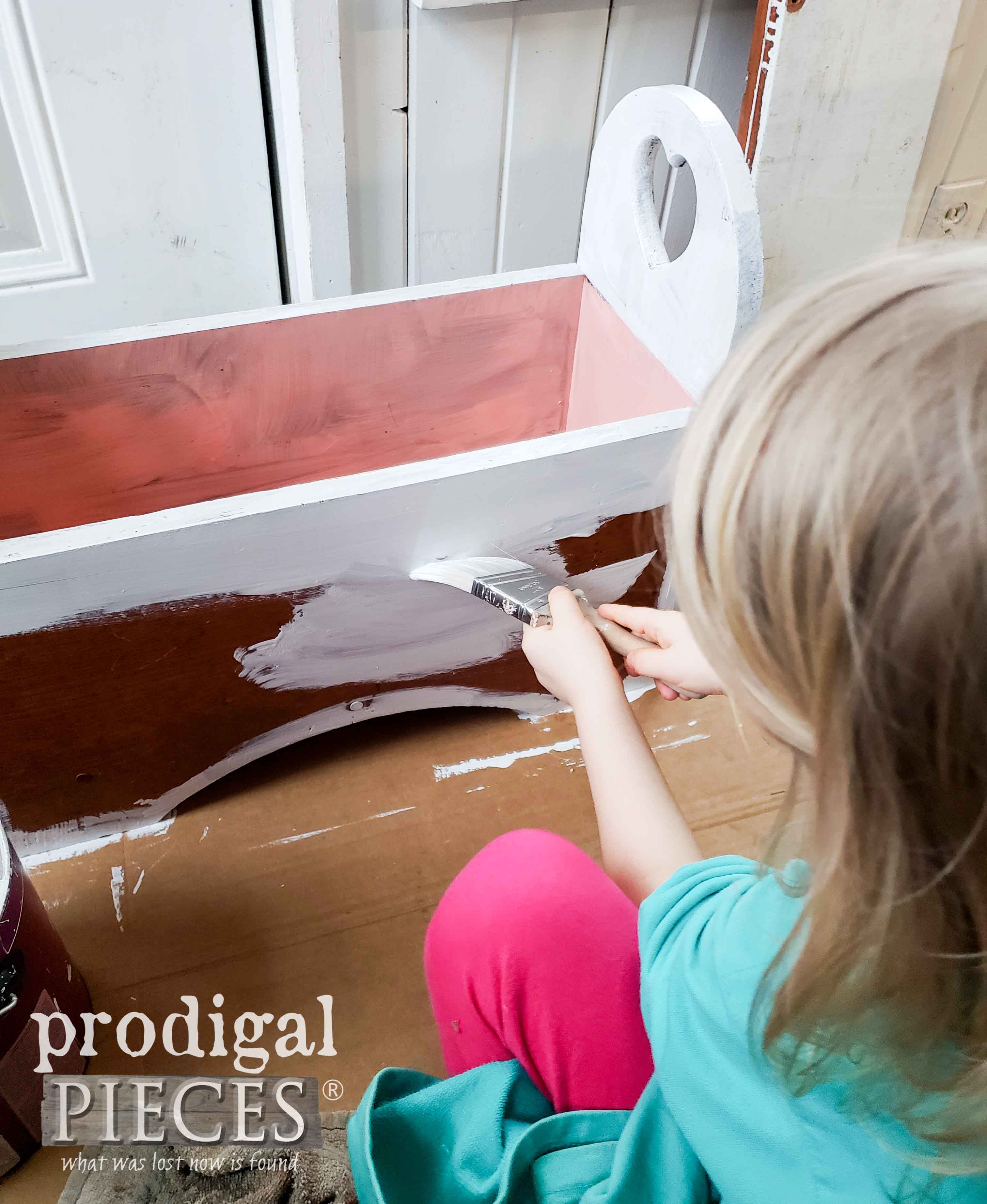 Little Girl Helping Paint Kids Storage Bench | prodigalpieces.com