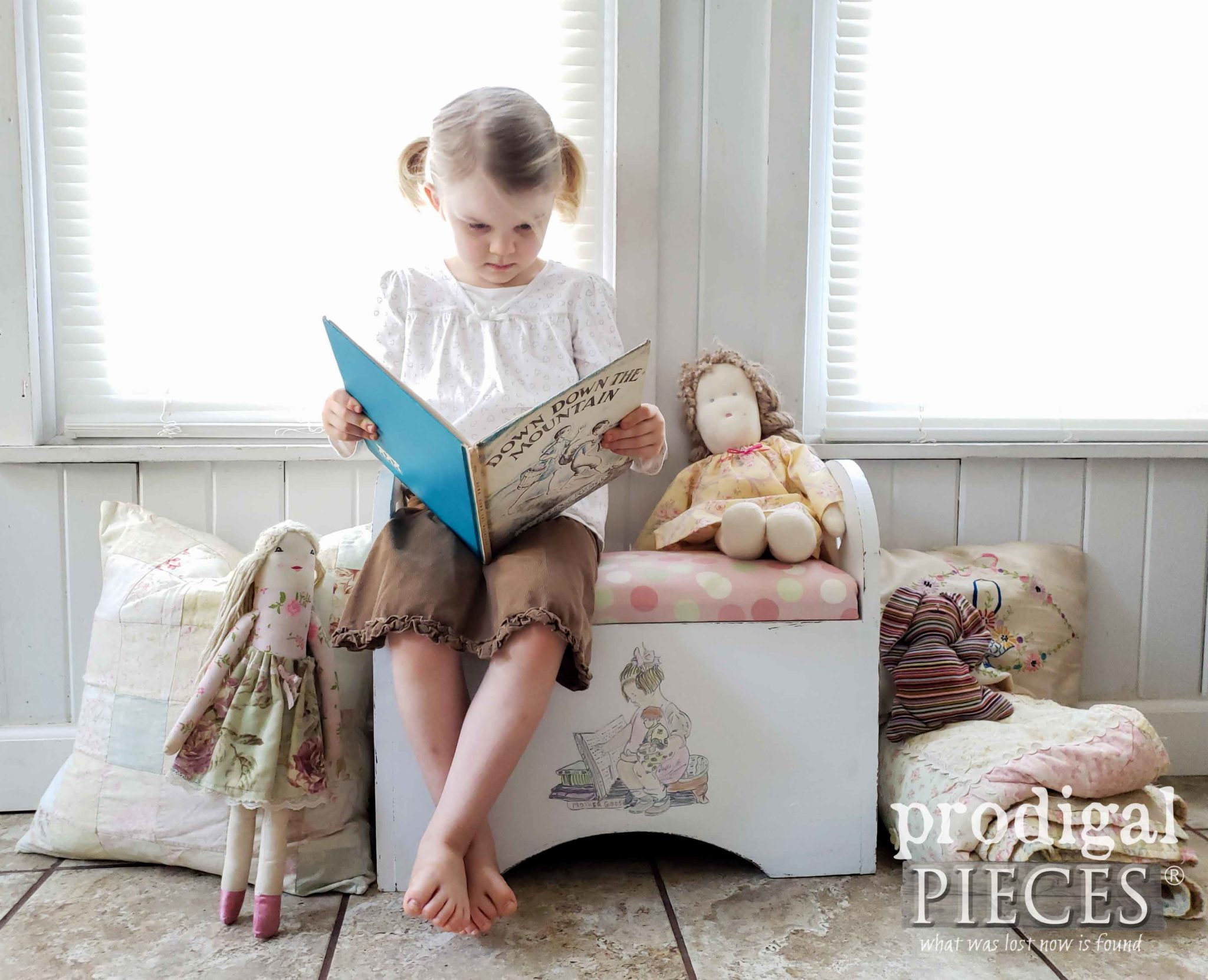 Girl Reading Book While Sitting on Kids Storage Bench by Larissa of Prodigal Pieces | prodigalpieces.com