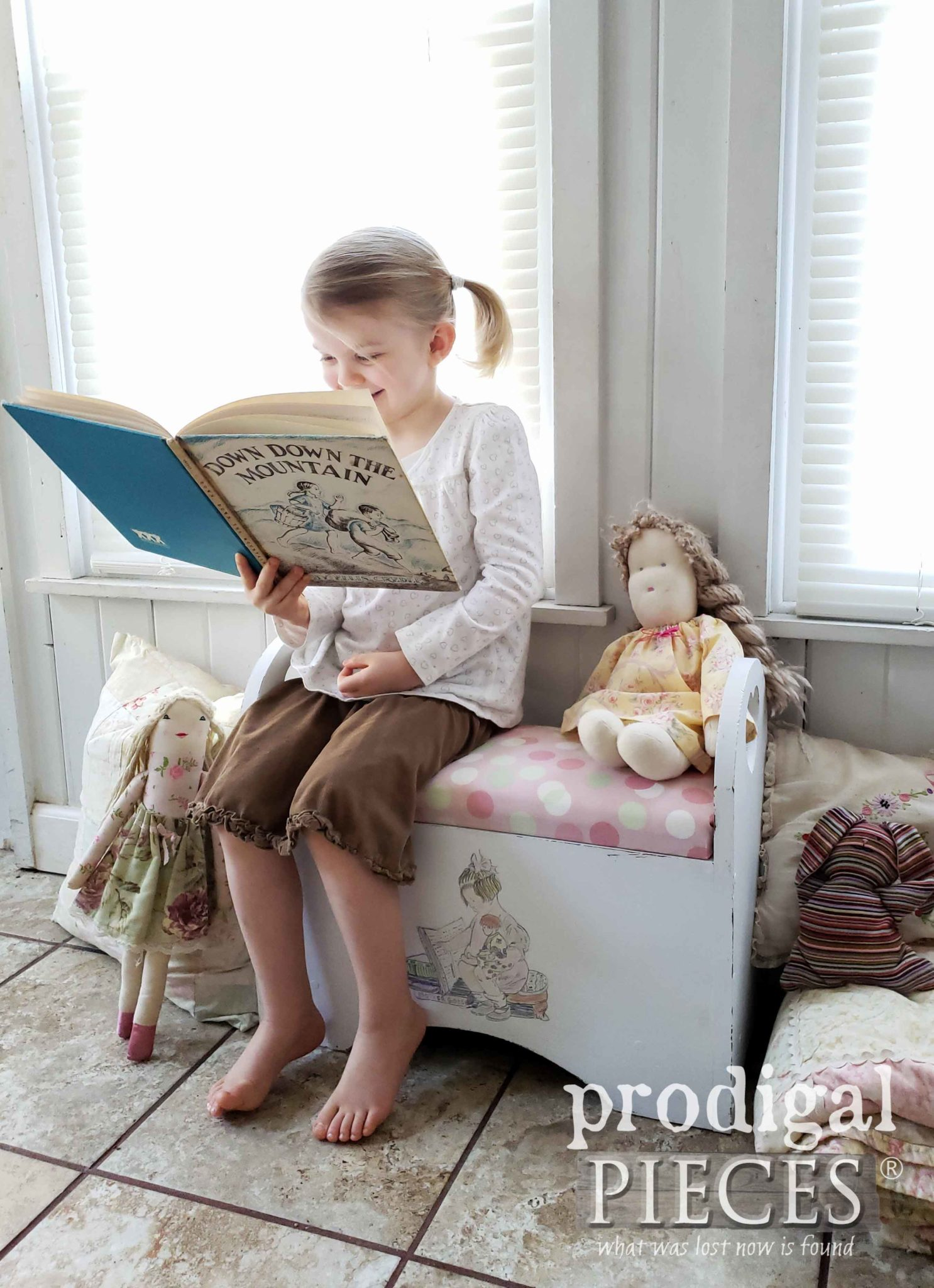 Little Girl Reading on Upcycled Child's Storage Bench by Larissa of Prodigal Pieces | prodigalpieces.com