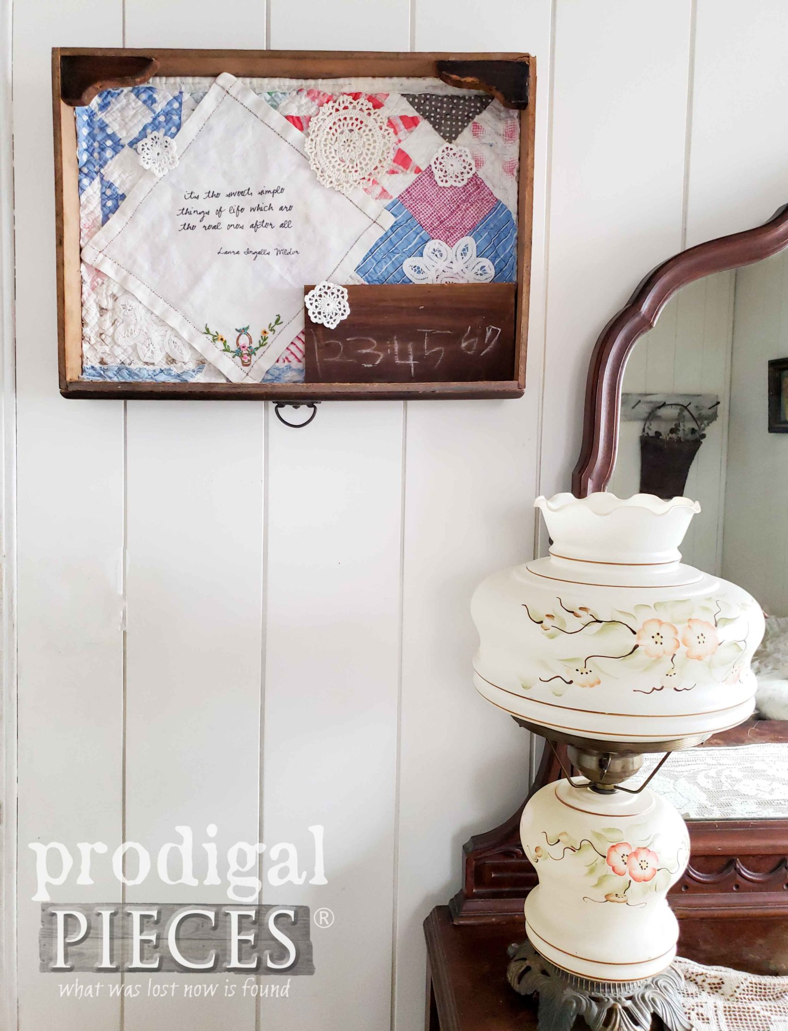 Prairie Farmhouse Vignette Created with an Antique Desk Drawer Shadow Box with Hand-Stitched Quilt, Vintage Hankie, and Doilies | DIY at Prodigal Pieces | prodigalpieces.com #prodigalpieces #handmade #farmhouse #diy #home #homedecor #vintage #homedecorideas