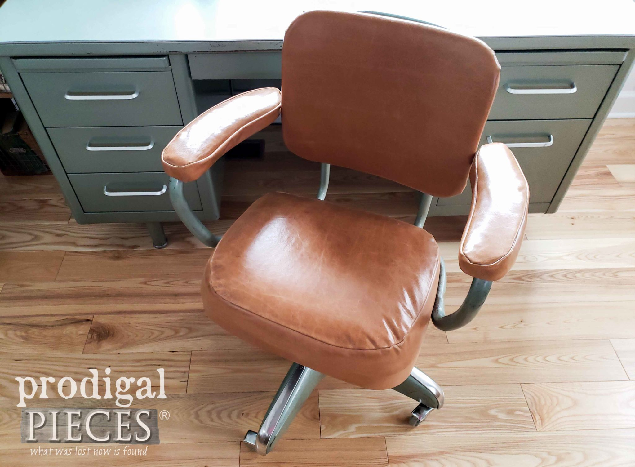 DIY Tutorial on How to Cover a Vintage Industrial Office Chair with Leather by Larissa of Prodigal Pieces | Video Tutorial at prodigalpieces.com #prodigalpieces #furniture #home #retro #homedecor #vintage #videos