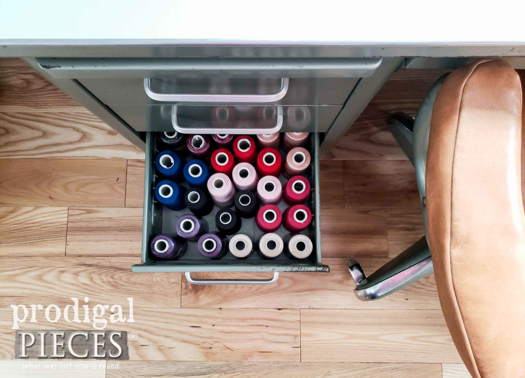 Open Drawer of Spools of Thread in Vintage Office Desk | Prodigal Pieces | prodigalpieces.com #prodigalpieces #diy #retro #home #furniture #sewing #vintage