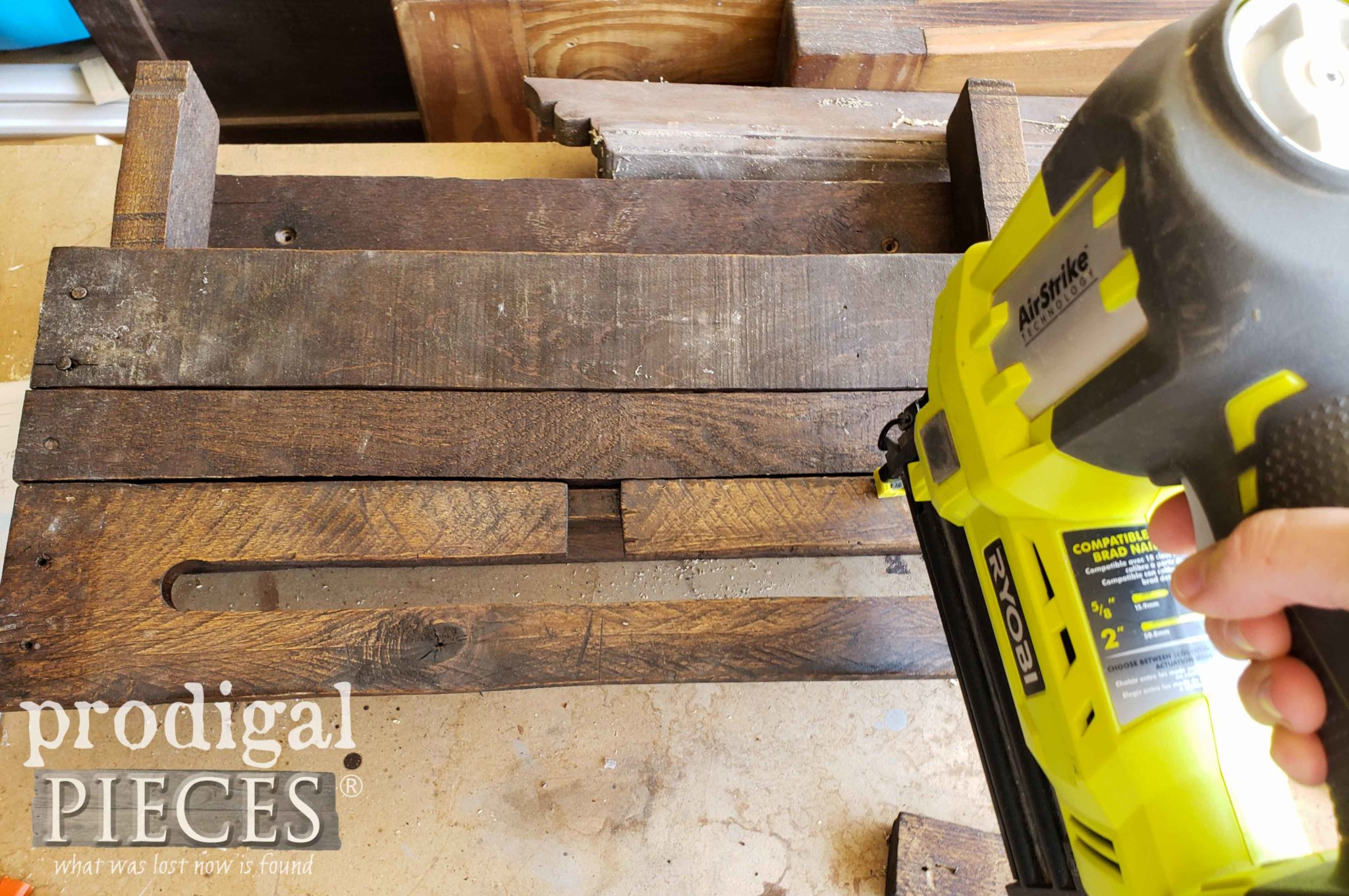 Attaching Towel Bar to Front of Upcycled Pallet Wall Decor | prodigalpieces.com