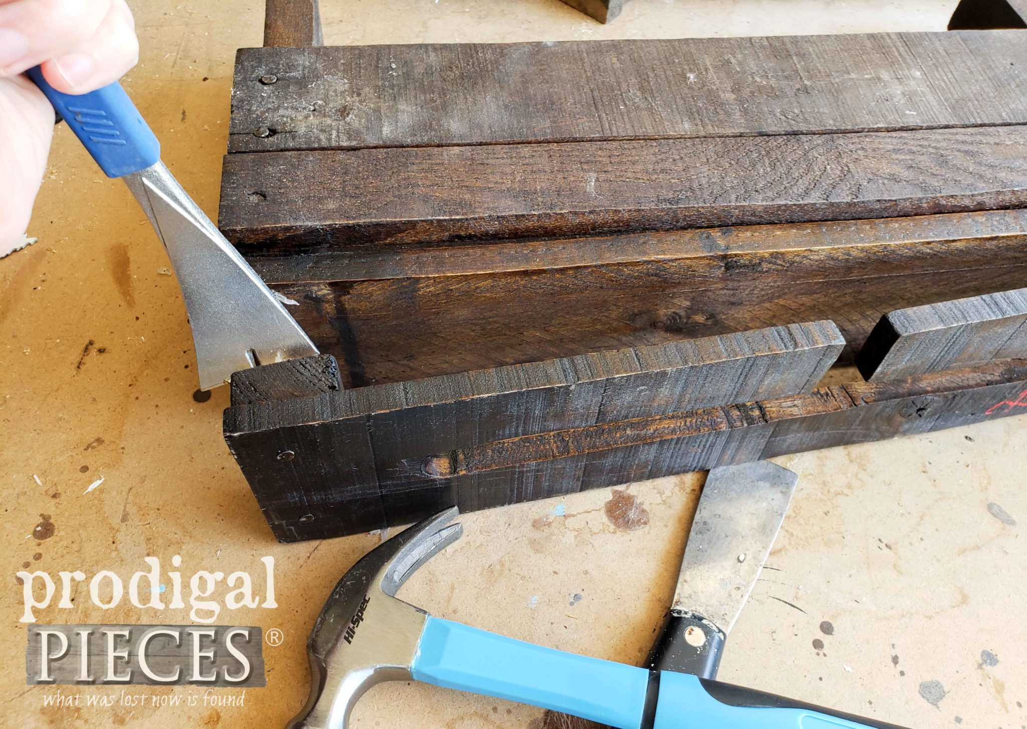 Removing Upcycled Pallet Wine Rack Bottom | prodigalpieces.com