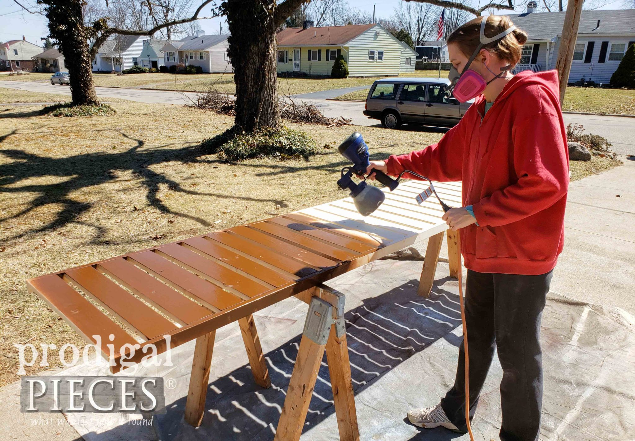 Spraying Stain on DIY Shoe Storage with HomeRight Super Finish Max Extra | by Prodigal Pieces | prodigalpieces.com #prodigalpieces #diy #home #homedecor #storage