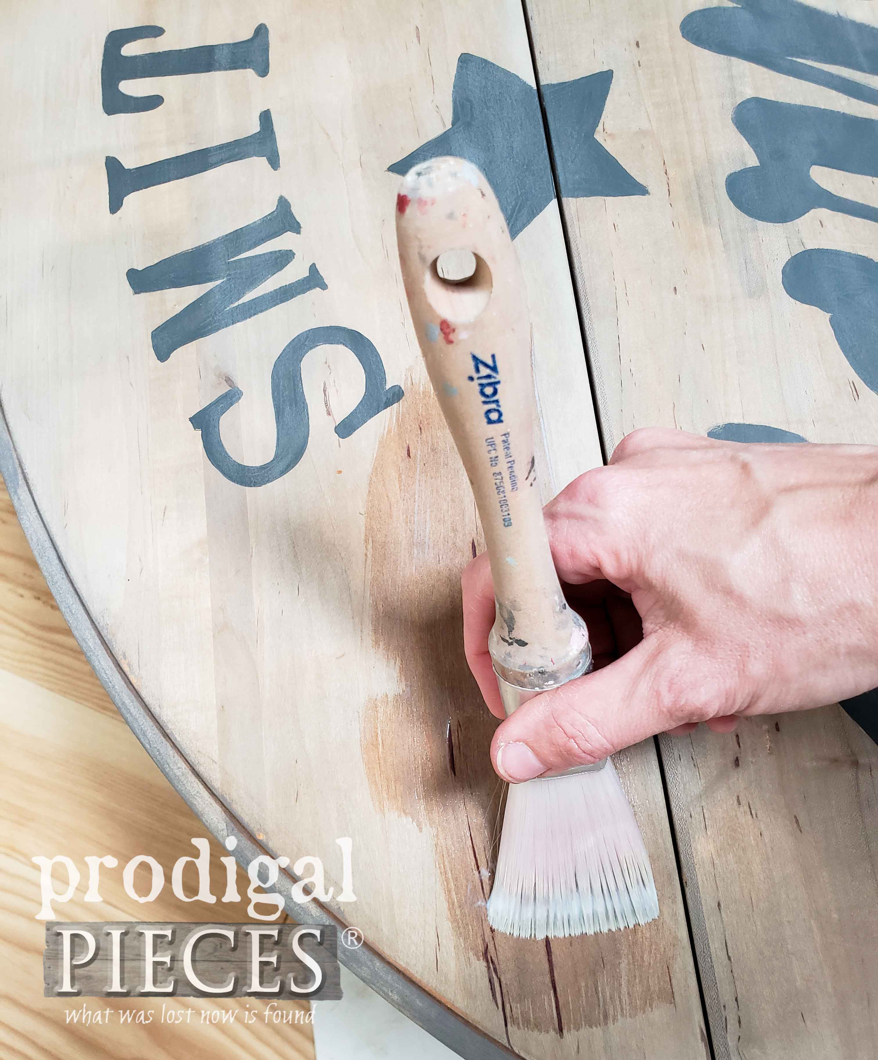Applying Matte Poly Topcoat with Zibra Fan Brush on Farmhouse Drop-Leaf Coffee Table   by Larissa of Prodigal Pieces   prodigalpieces.com #prodigalpieces #diy #furniture #home #homedecor