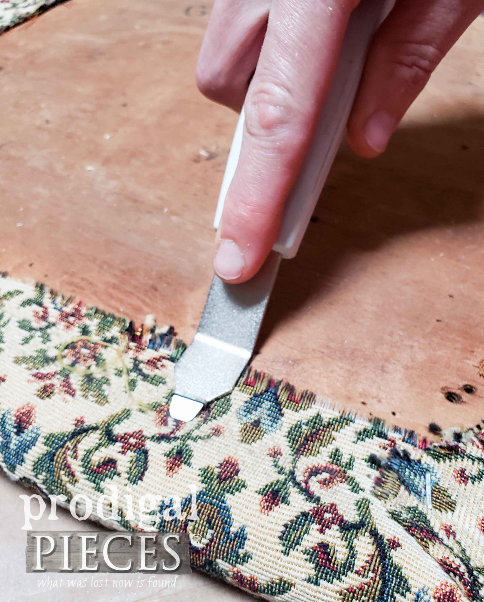 Using Staple Puller to Remove Old Upholstery by Larissa of Prodigal Pieces | prodigalpieces.com #prodigalpieces