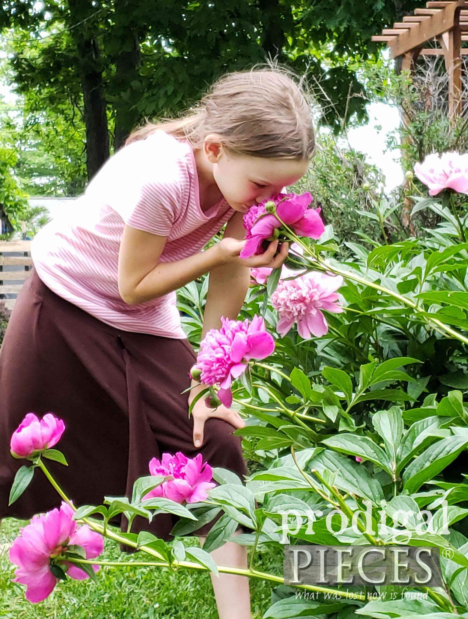 Girl Smelling Peonies | prodigalpieces.com #prodigalpieces #flower #peony #garden