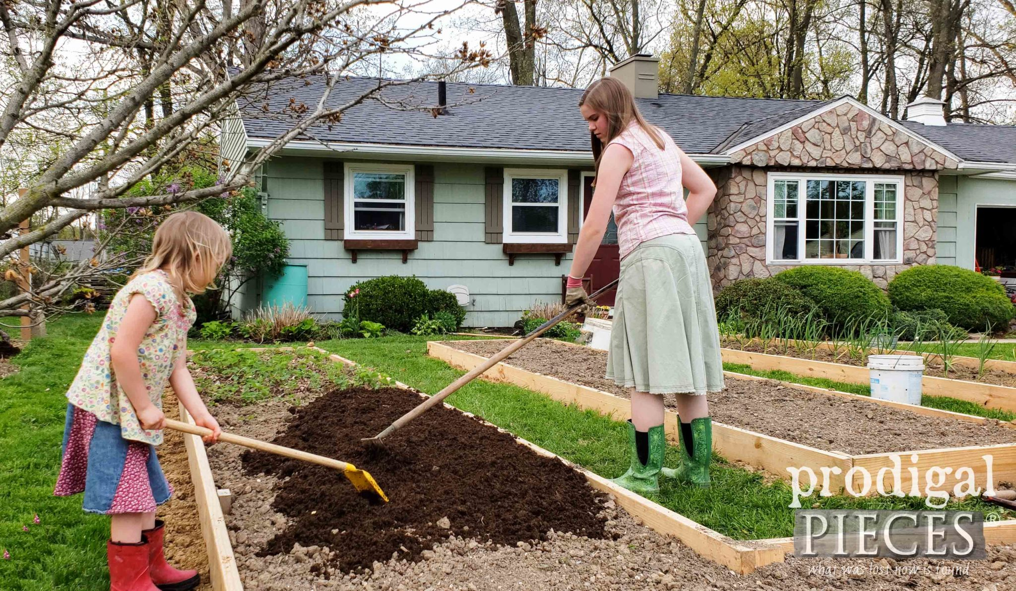 Kids Helping Spread Manure in Garden | prodigalpieces.com