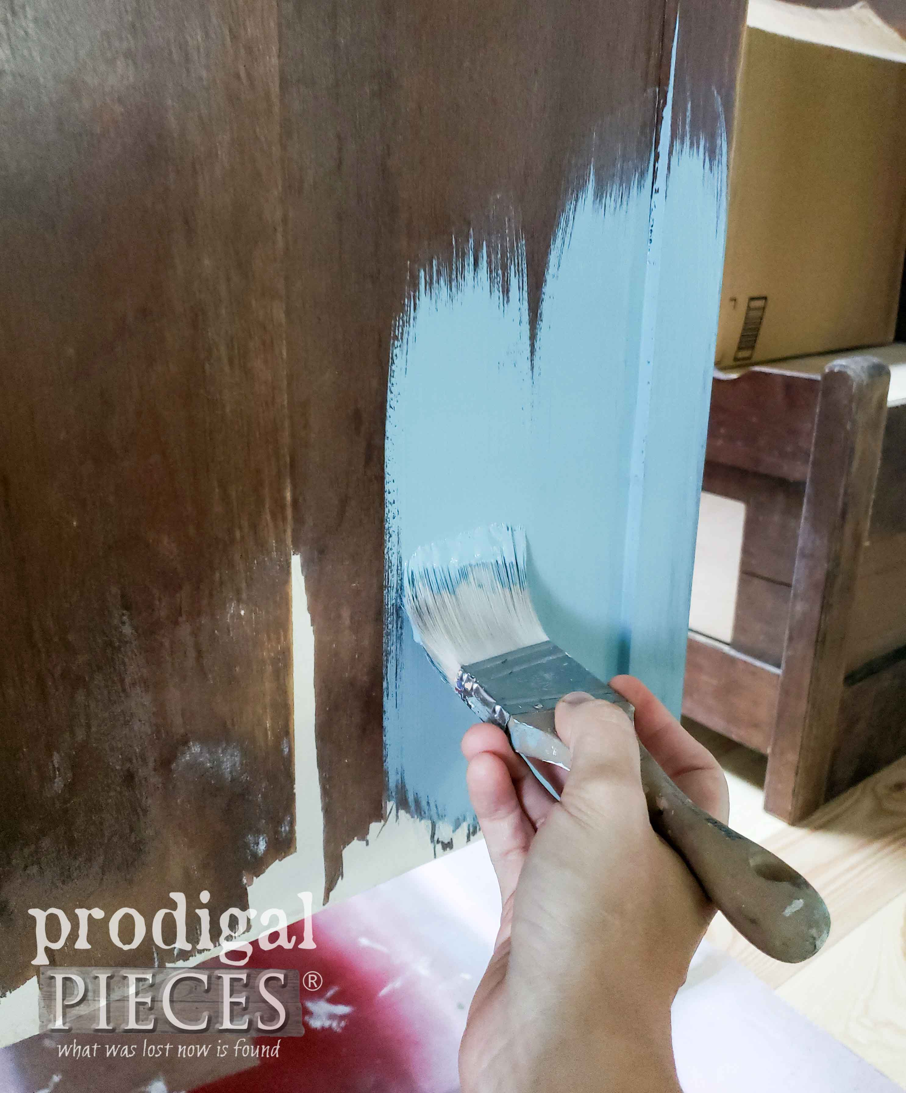 Applying Blue Layer of DIY Denim Paint to Antique Chest of Drawers with Zibra Paint Brushes by Prodigal Pieces | prodigalpieces.com