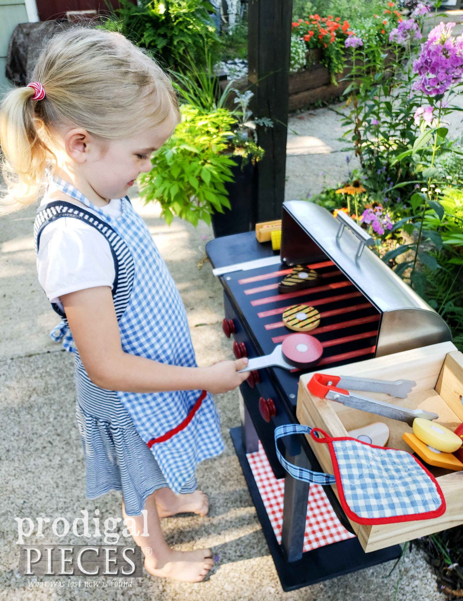 Toddler Girl with Pretend Play Grilling Food Set and Grill made by Prodigal Pieces | prodigalpieces.com #prodigalpieces #diy #home #handmade #homedecor #kids #toys
