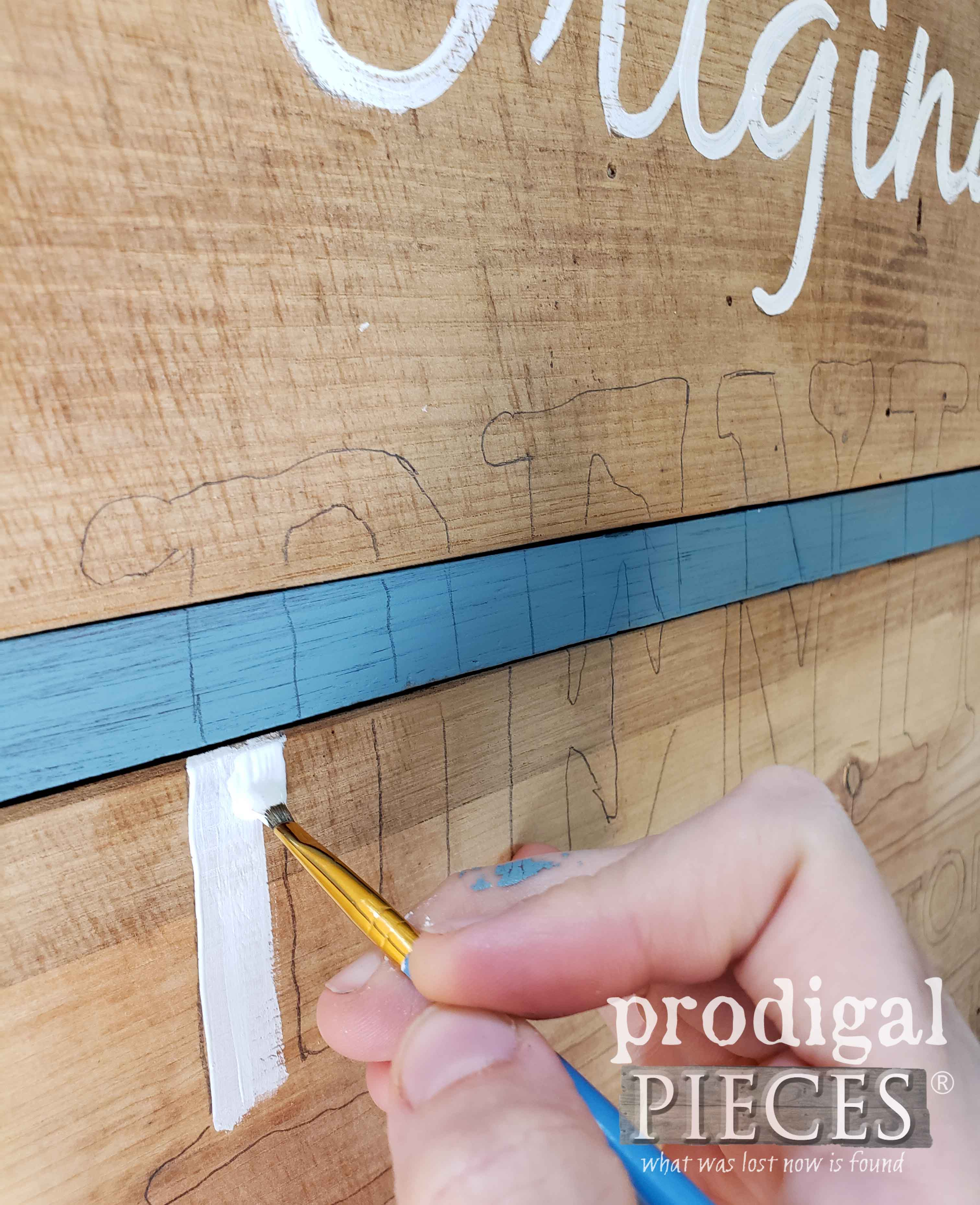 Hand-painting typography onto antique chest of drawers | prodigalpieces.com