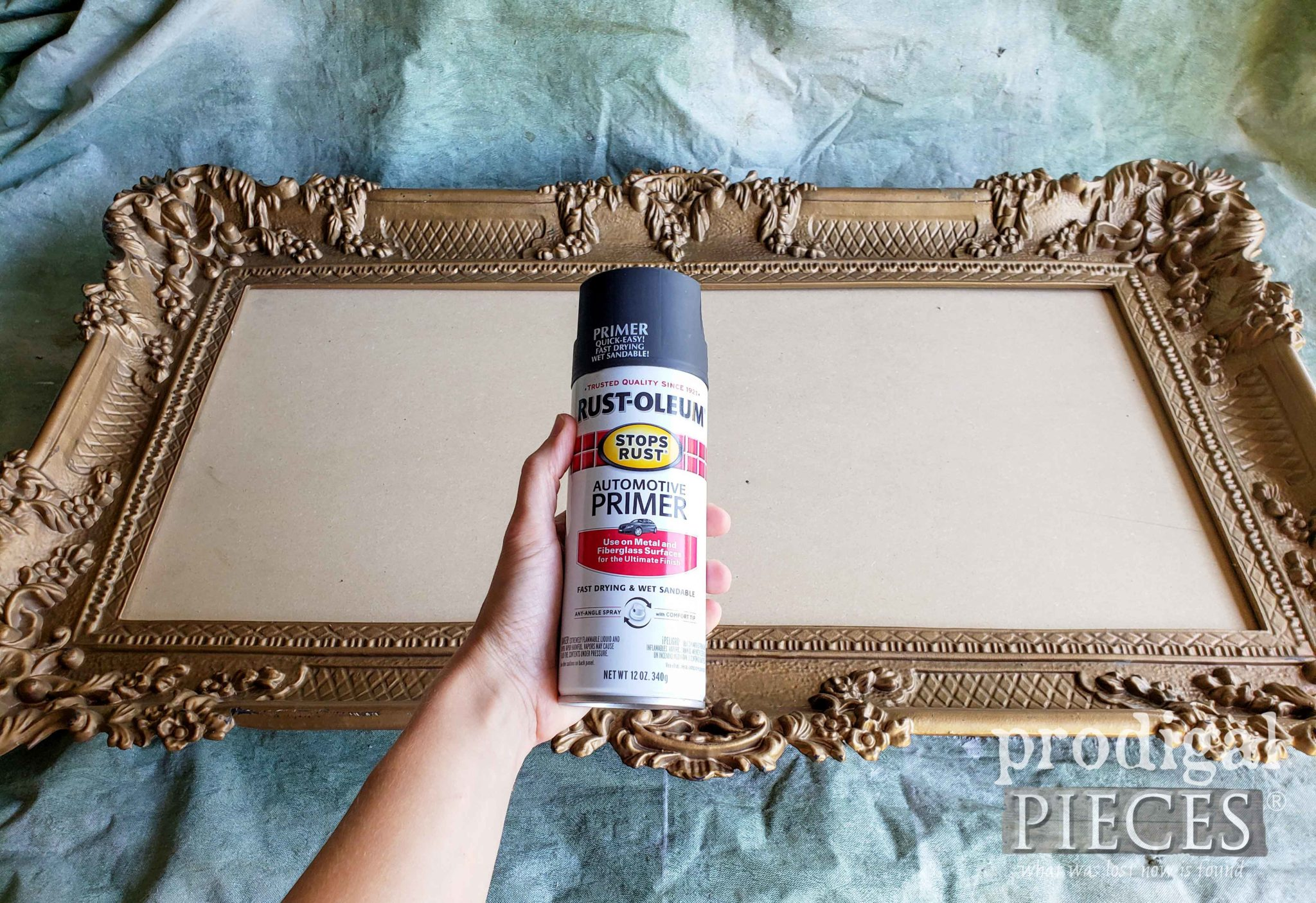 Priming Ornate Frame with Dark Flat Gray Spray Paint | prodigalpieces.com