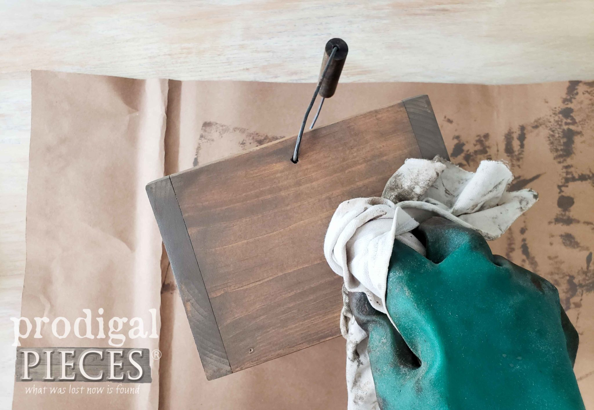 Wiping off excess stain on kitchen caddy | prodigalpieces.com