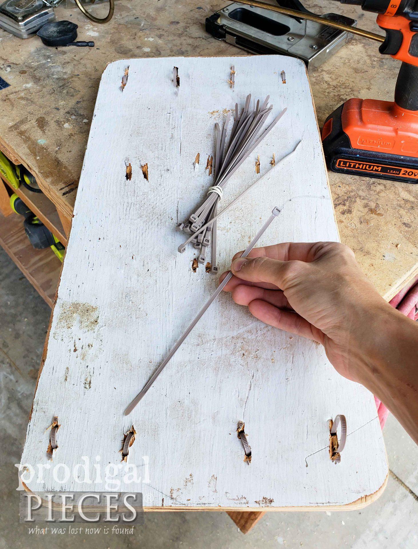Inserting Zip Ties into DIY Vanity Seat   prodigalpieces.com