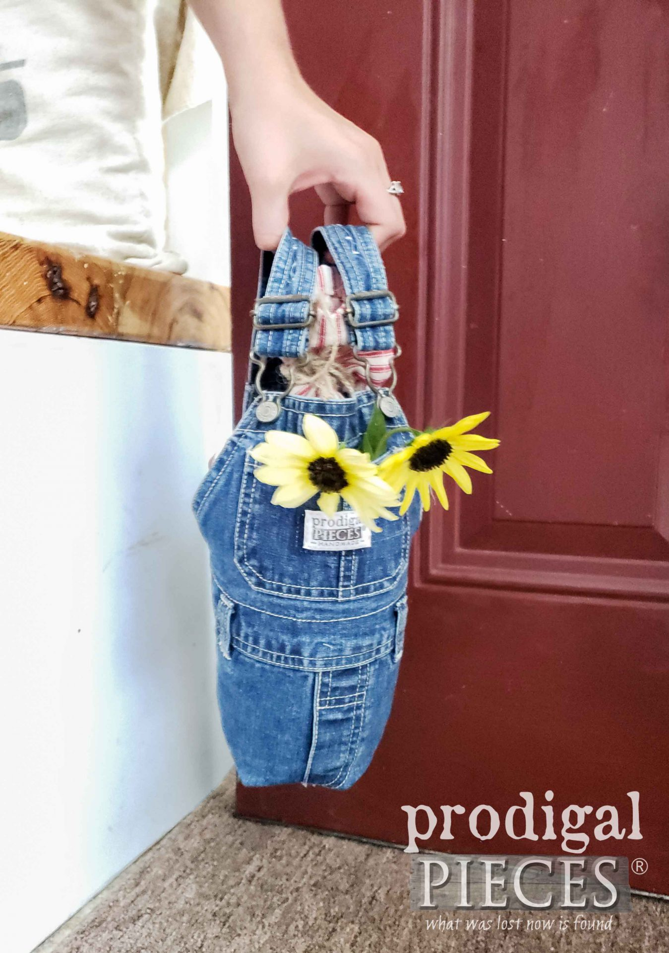 Adorable Baby Bib Overalls Upcycled into Farmhouse Style DIY Doorstop by Larissa of Prodigal Pieces | prodigalpieces.com #prodigalpieces #diy #home #homedecor #farmhouse