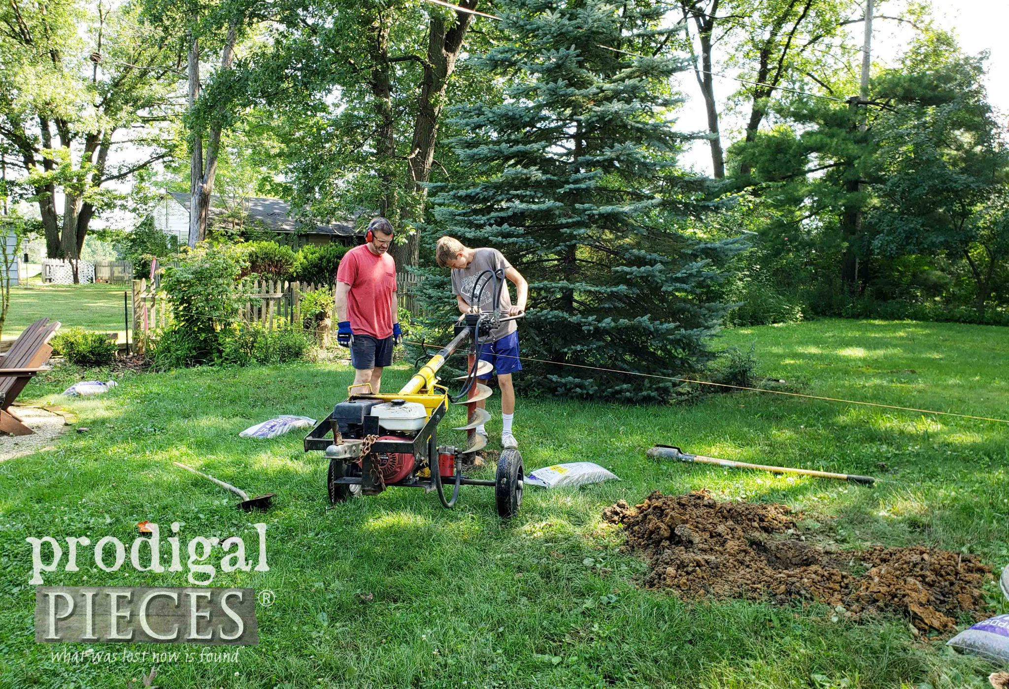 Father Son Team Working to Install a DIY Back Yard Privacy Fence | prodigalpieces.com