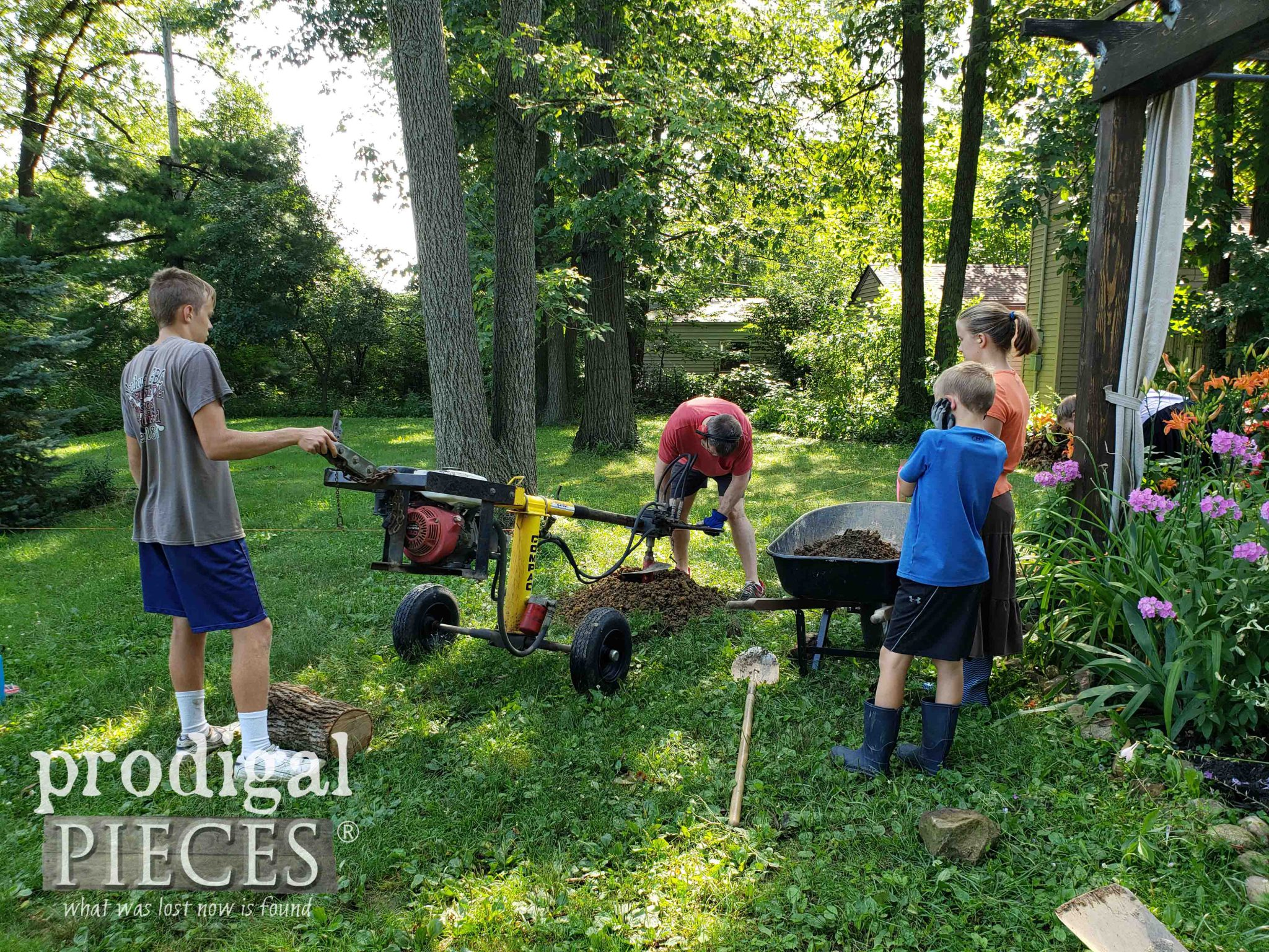 Family Working Together to Install a Privacy Fence with One-Man Post Hole Auger | prodigalpieces.com