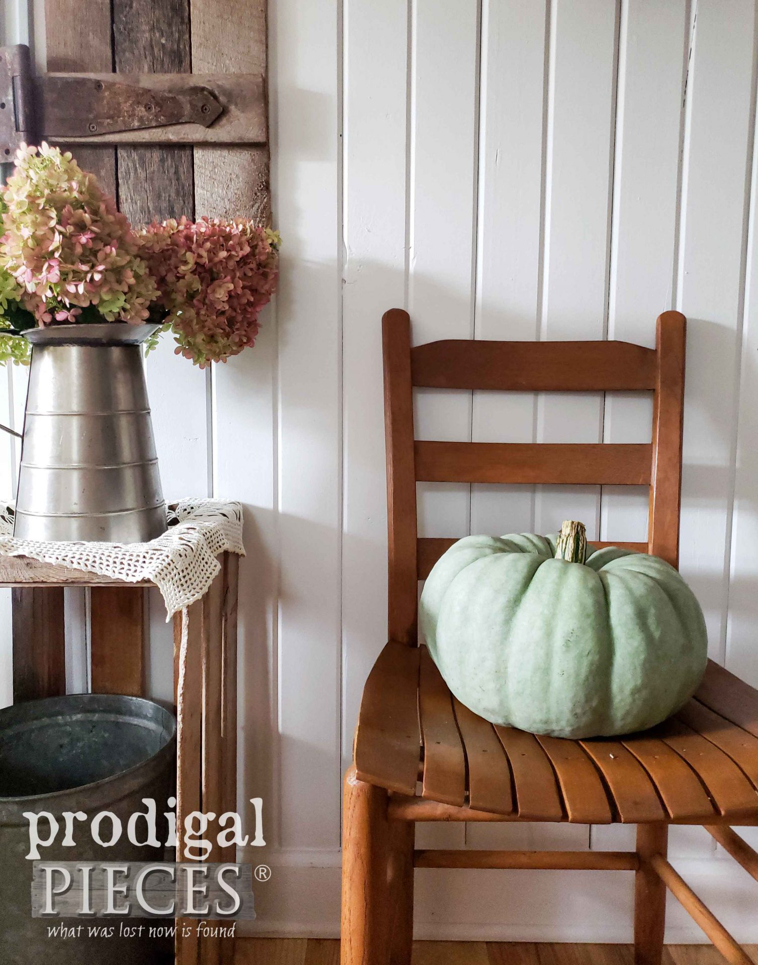 Blue Jarrahdale Pumpkin on Chair | Farmhouse Fall Vignette Decor by Larissa of Prodigal Pieces | prodigalpieces.com #prodigalpieces #farmhouse #pumpkin #home #homedecor #fall