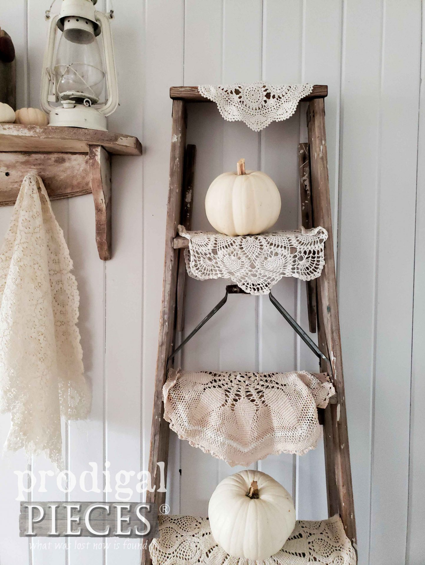 Old Ladder with White Pumpkins and Doilies by Larissa of Prodigal Pieces | prodigalpieces.com #prodigalpieces #home #farmhouse #fall #homedecor