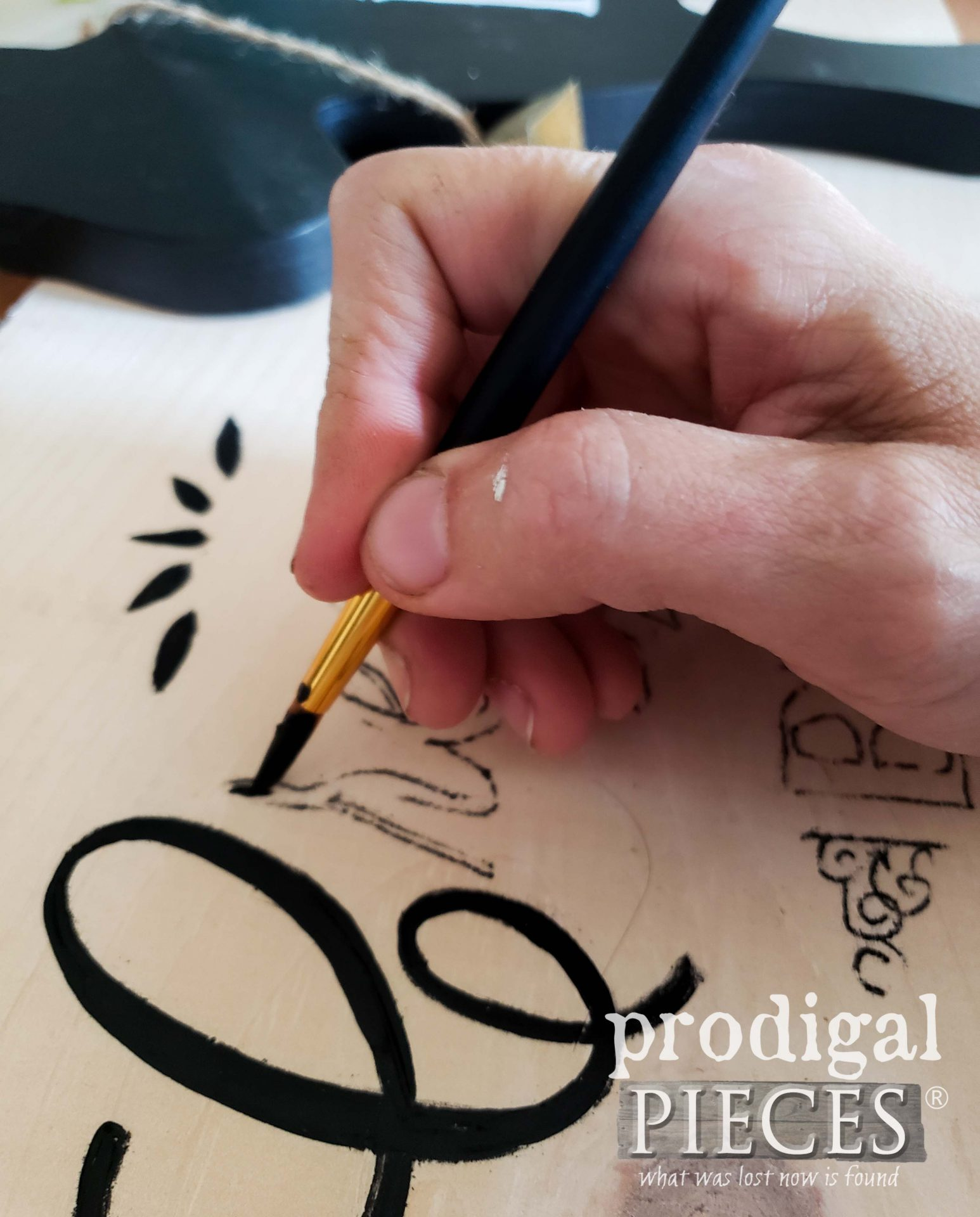 Hand-painting typography on DIY Farmhouse Sign Tutorial by Larissa of Prodigal Pieces | prodigalpieces.com