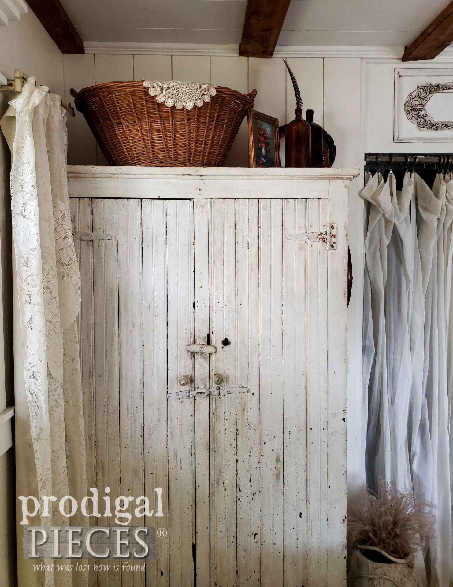 Chippy White Farmhouse Cupboard used as Armoire in Bedroom by Prodigal Pieces | prodigalpieces.com #prodigalpieces #home #farmhouse #bedroom #homedecor