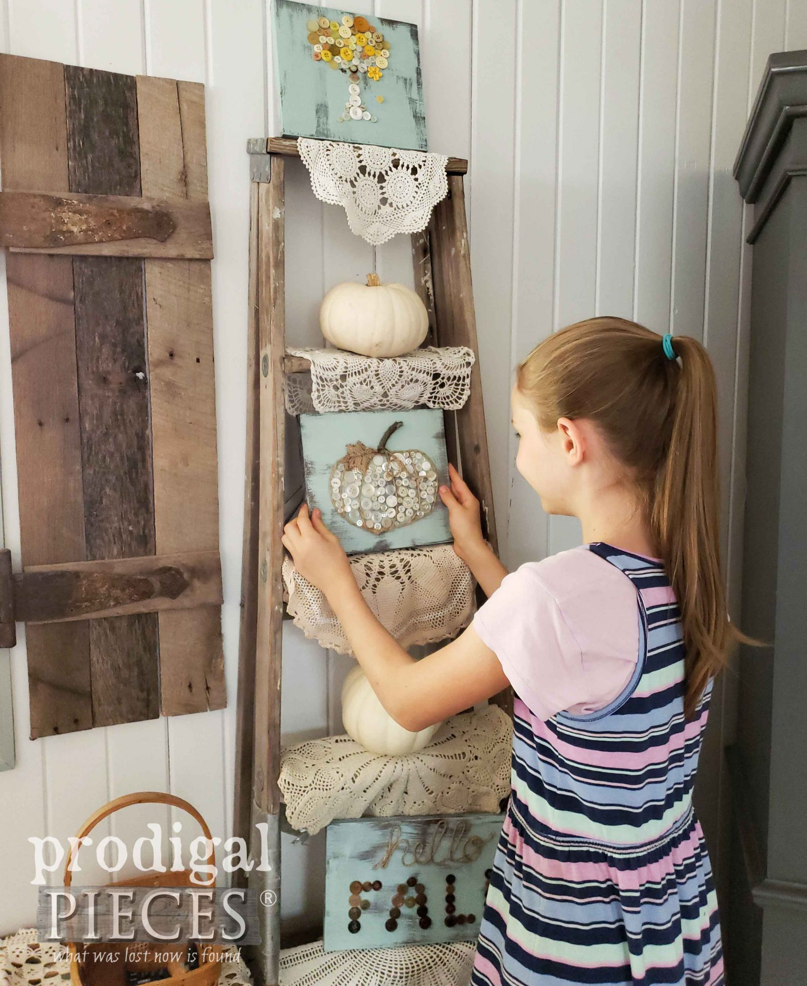 Girl Hanging DIY Button Art for Fall Decor | Prodigal Pieces Kids CREATE video tutorial at prodigalpieces.com #prodigalpieces #diy #home #homedecor #kids #crafts #farmhouse