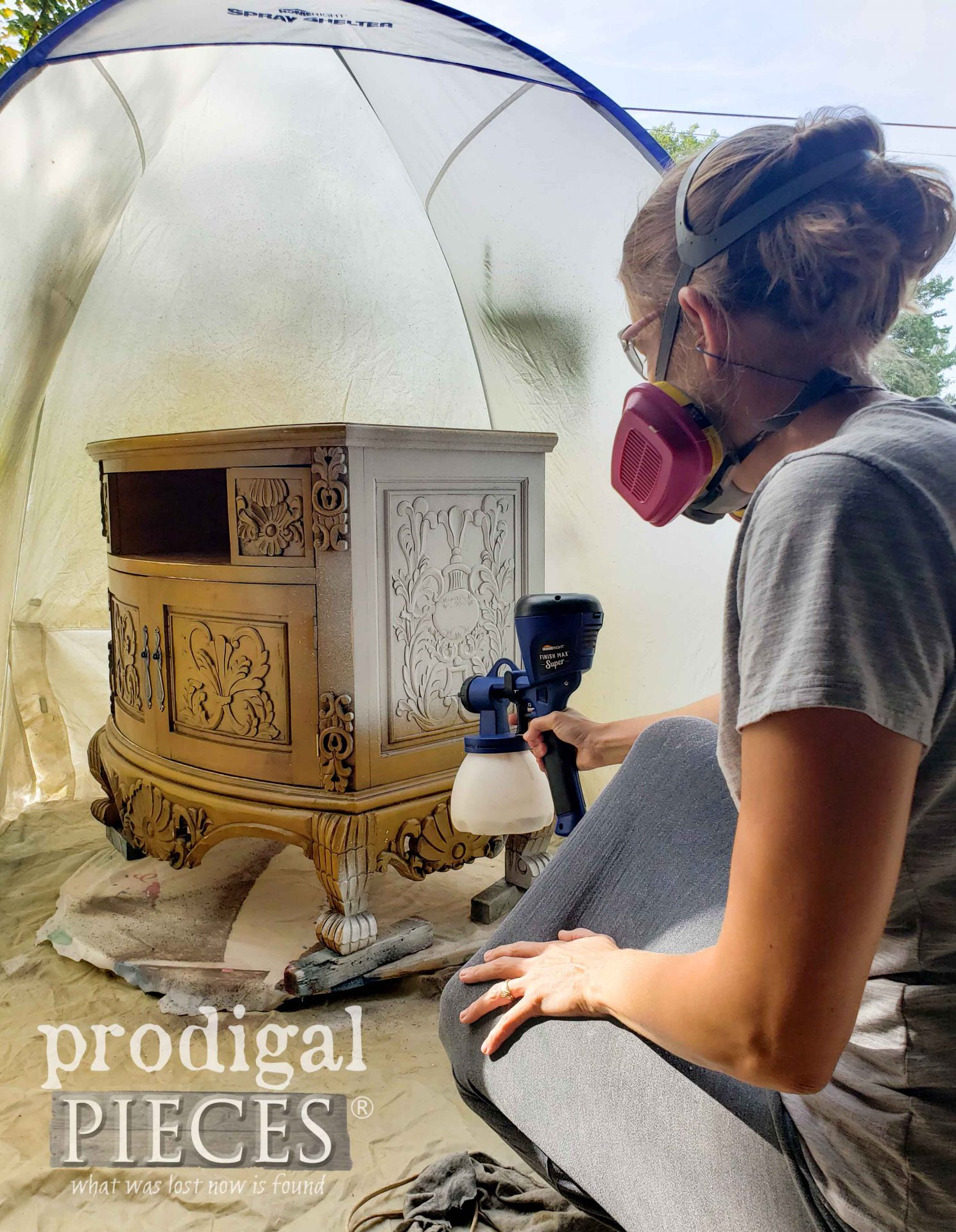 Larissa of Prodigal Pieces Priming Entertainment Stand with Gripper Primer using the HomeRight Super Finish Max Extra Sprayer | prodigalpieces.com