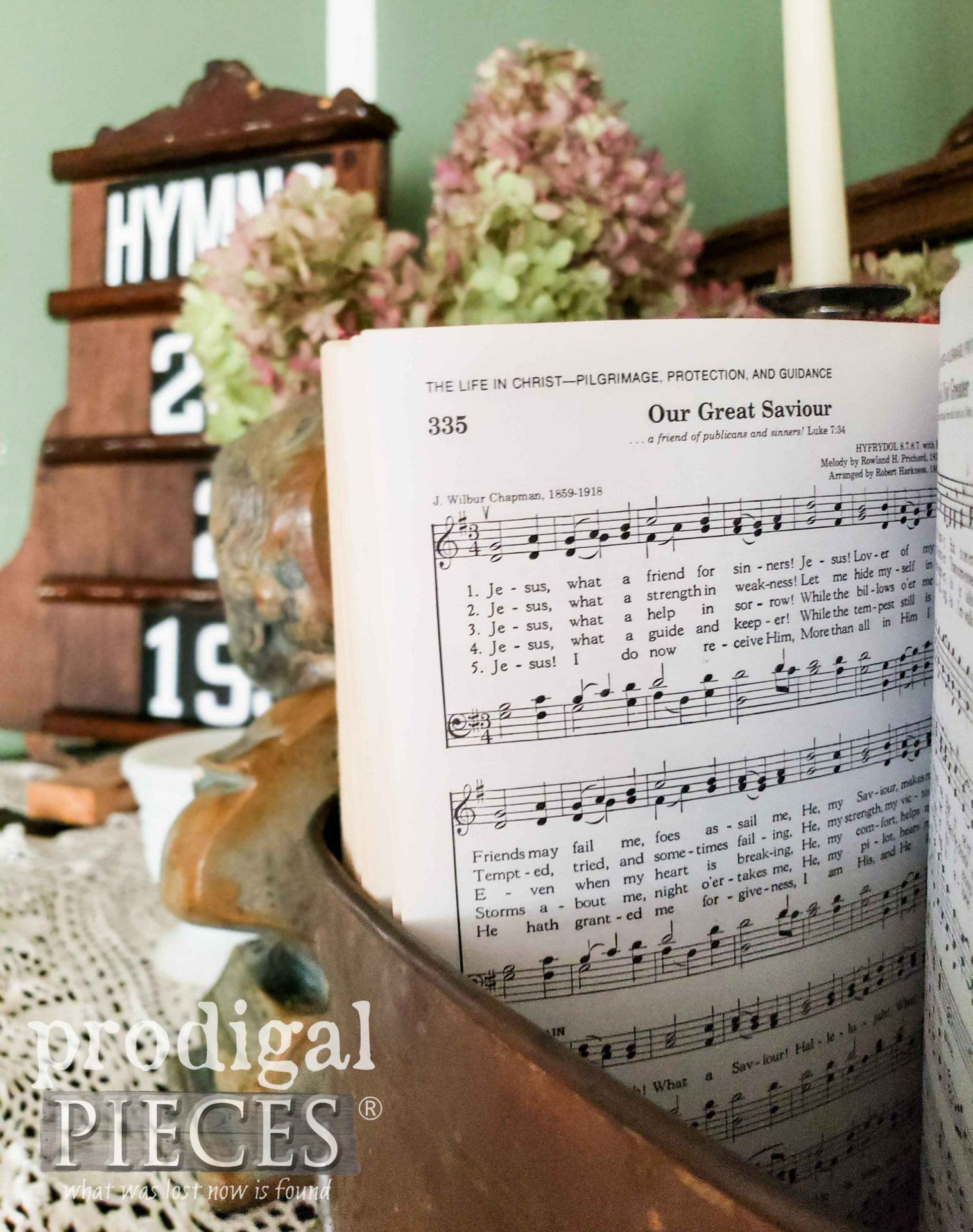 Old Hymnal and Upcycled Hymnal Board in Home of Larissa of Prodigal Pieces | prodigalpieces.com #prodigalpieces #diy #home #homedecor #farmhouse